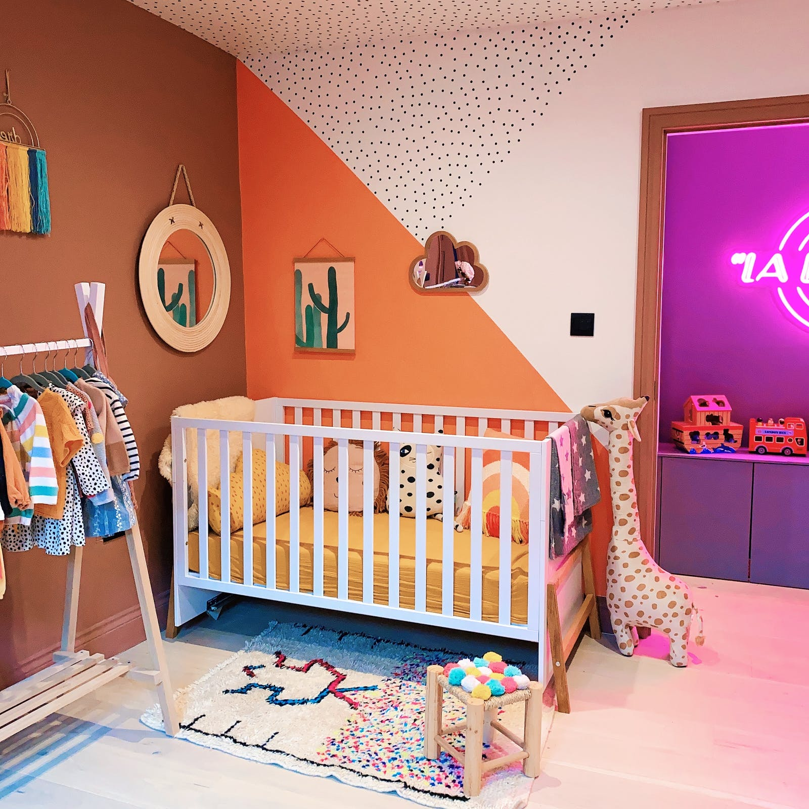 Kids room with polkadot detail and geometric shapes on the wall