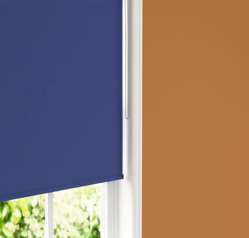 Close up of Lick Blue 08 roller blind against an Orange 02 wall