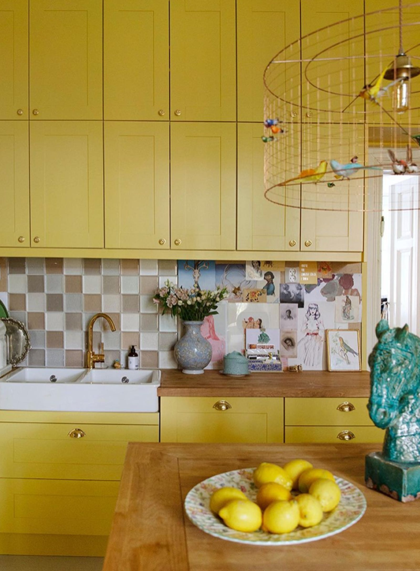 Kitchen painted in a vibrant yellow