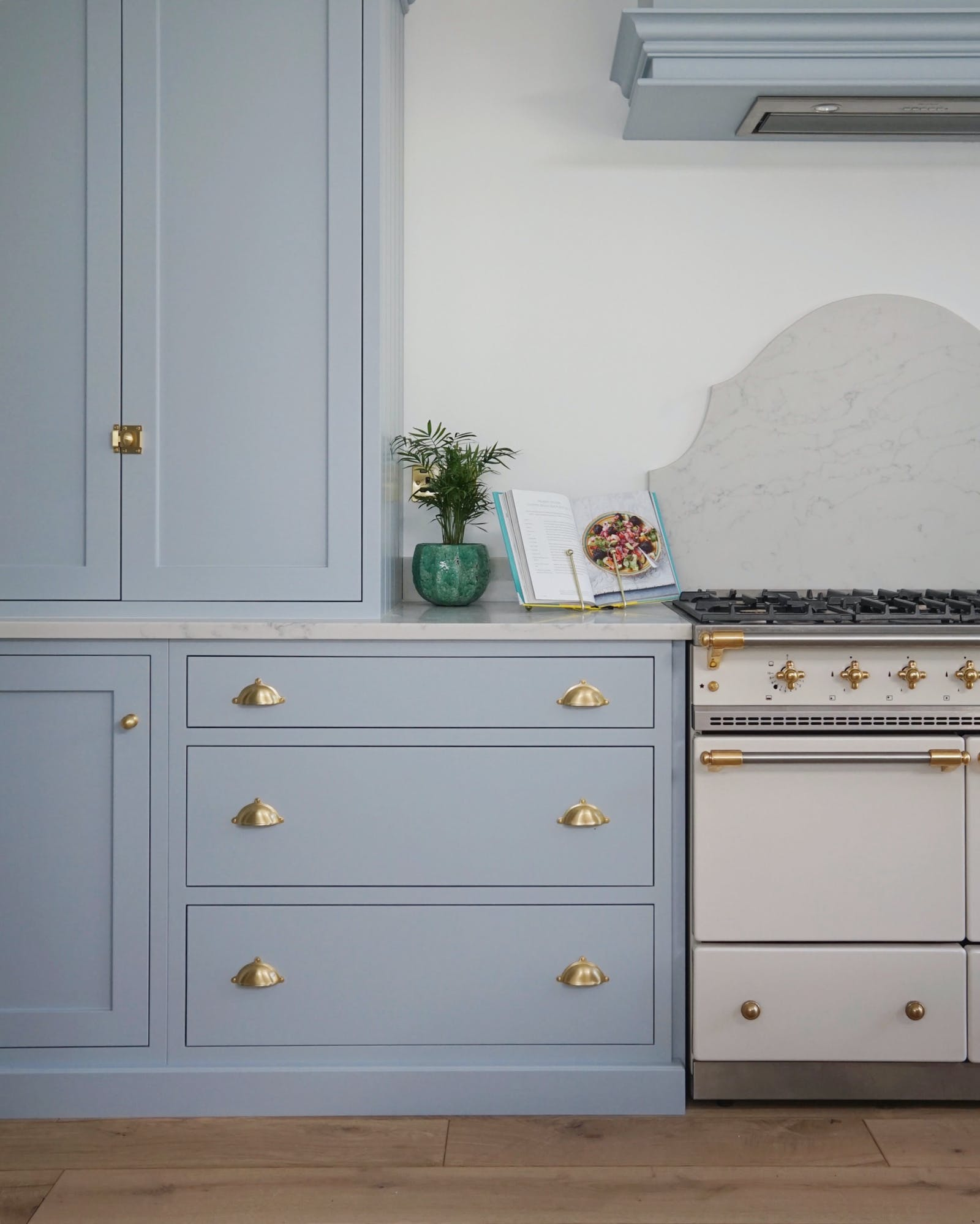 Kitchen cabinet painted in light blue