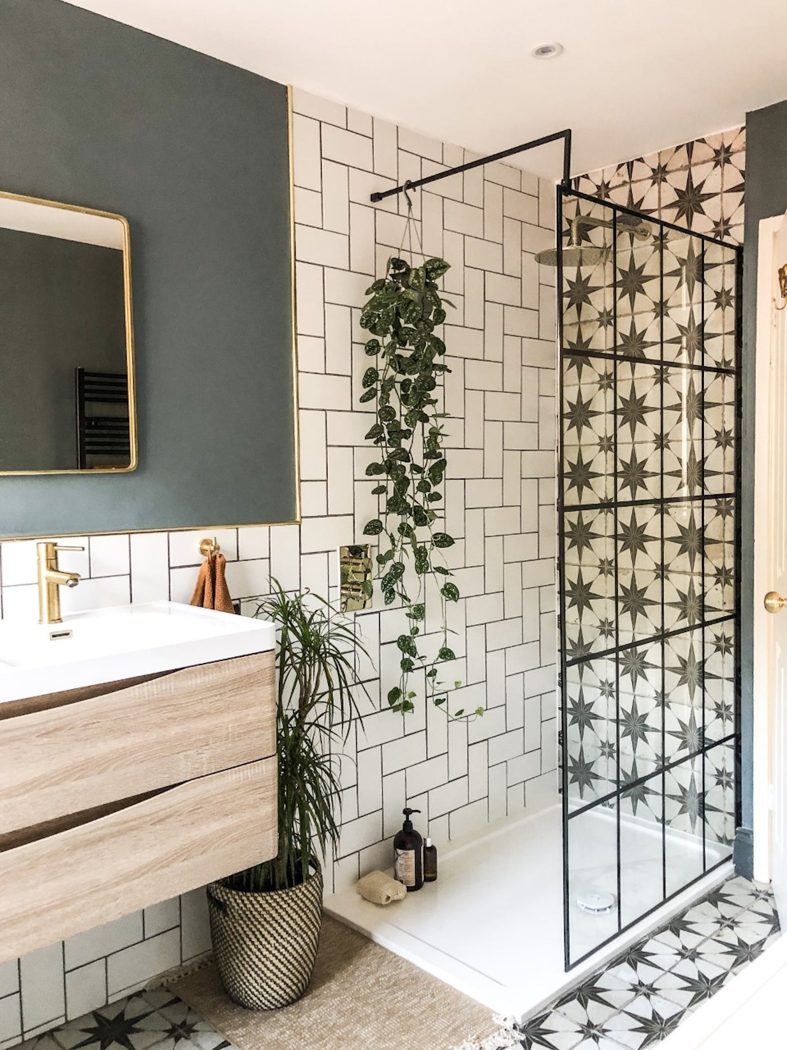 Bathroom with white tiles and a teal-painted wall behind the mirror