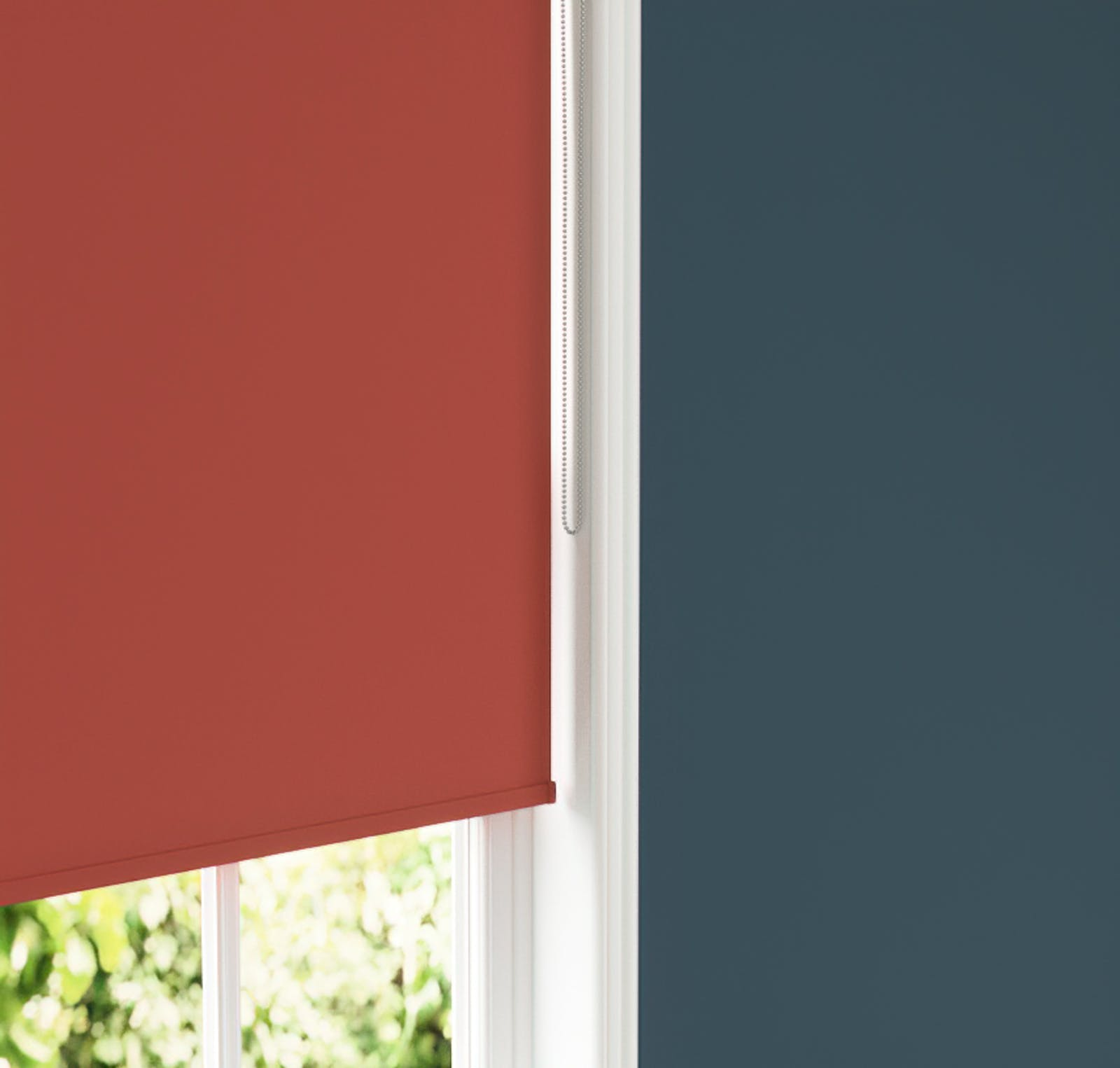 Close up image of Red 02 roller blinds and Blue 07 walls