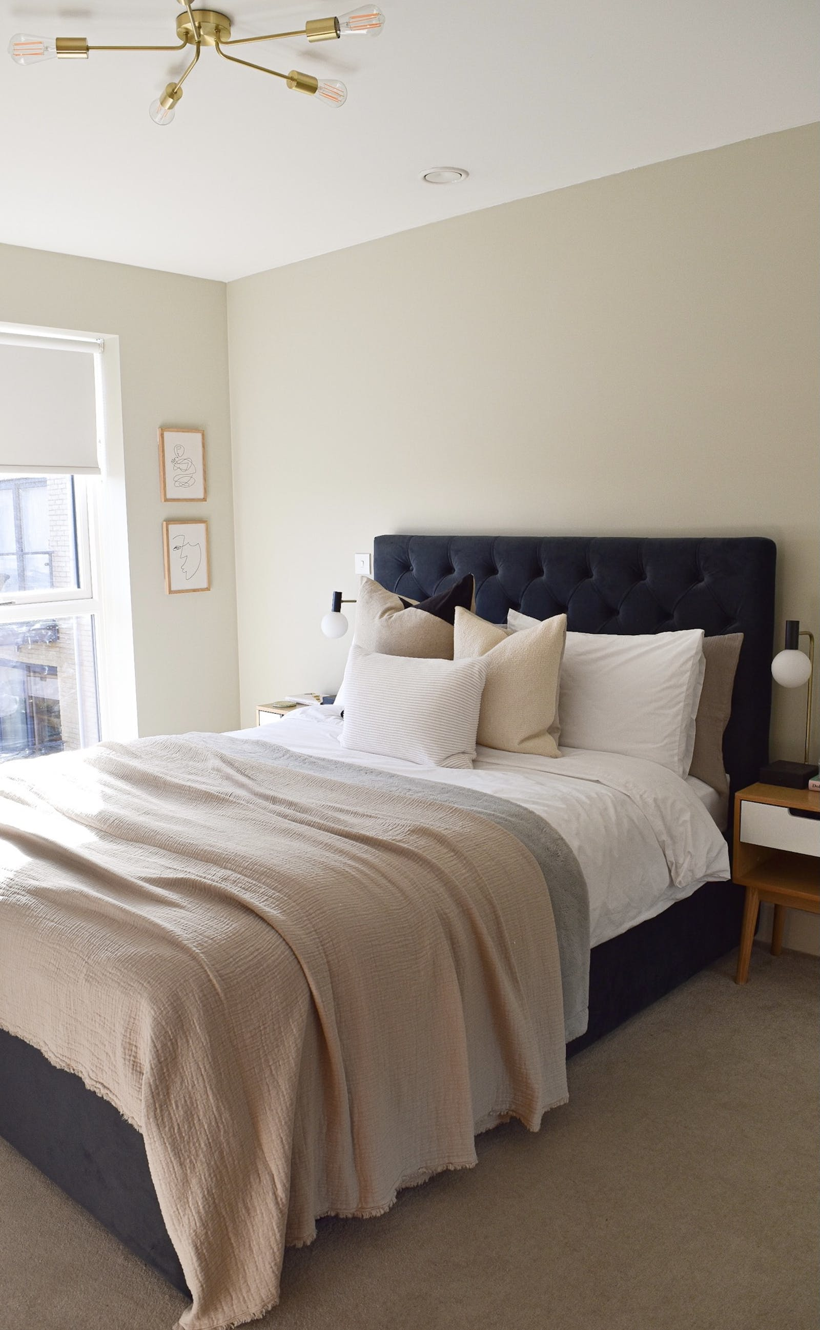 Bedroom painted in Greige 02 with a neutral soft furnishings