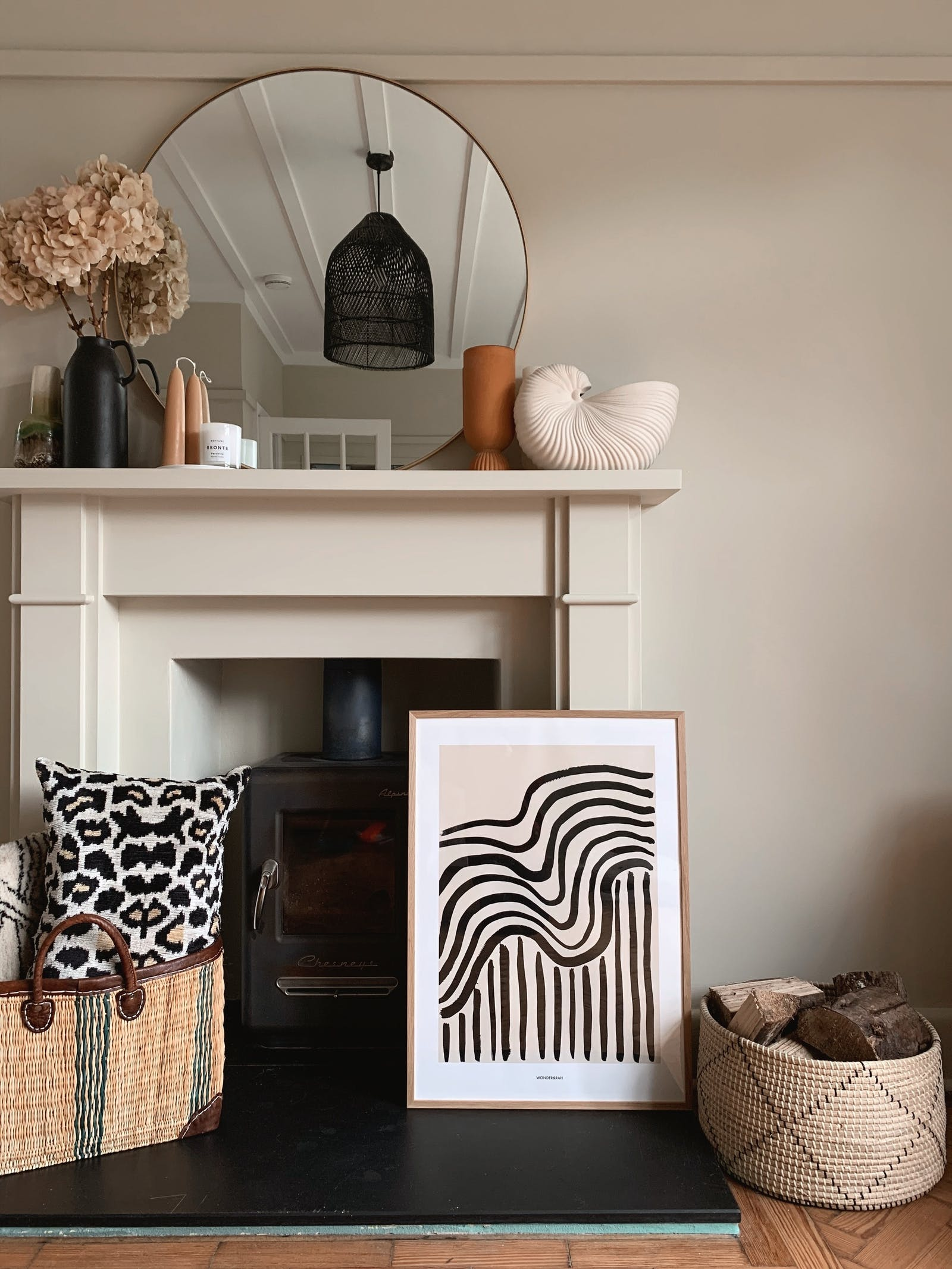 Fireplace decorated soft furnishings and artwork painted in Lick Beige 01