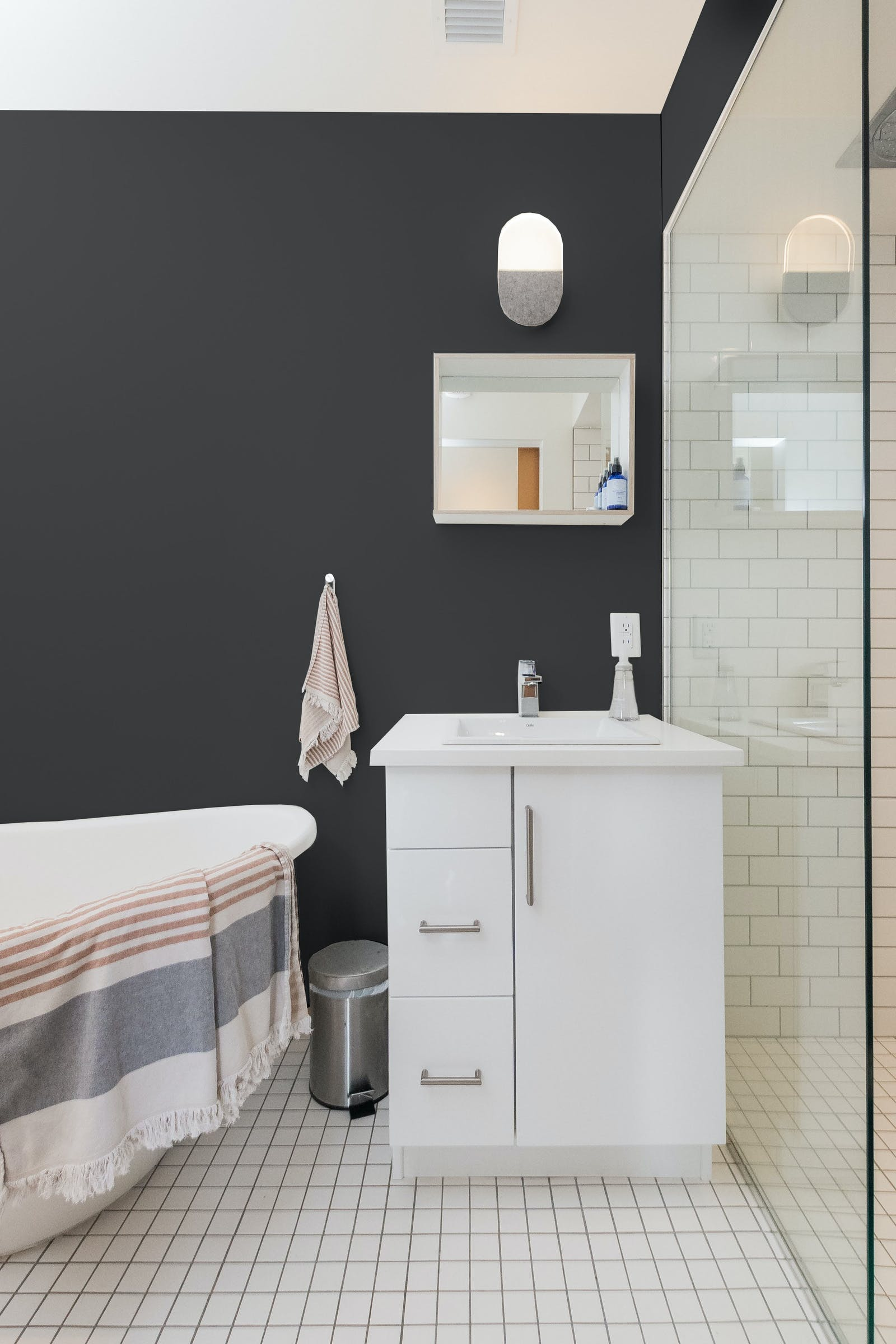 A black bathroom with white floors