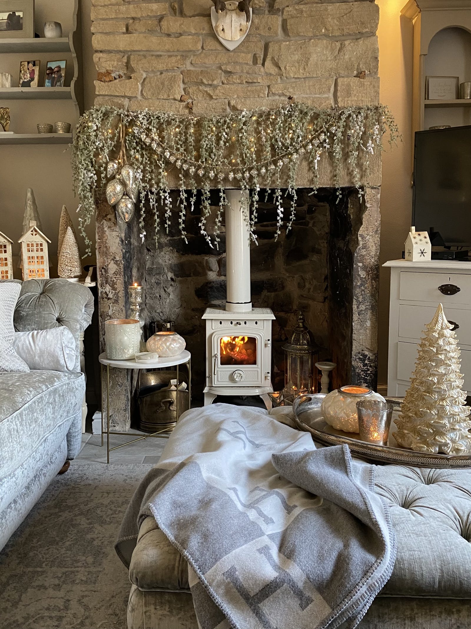 White fireplace surrounded by Christmas decor