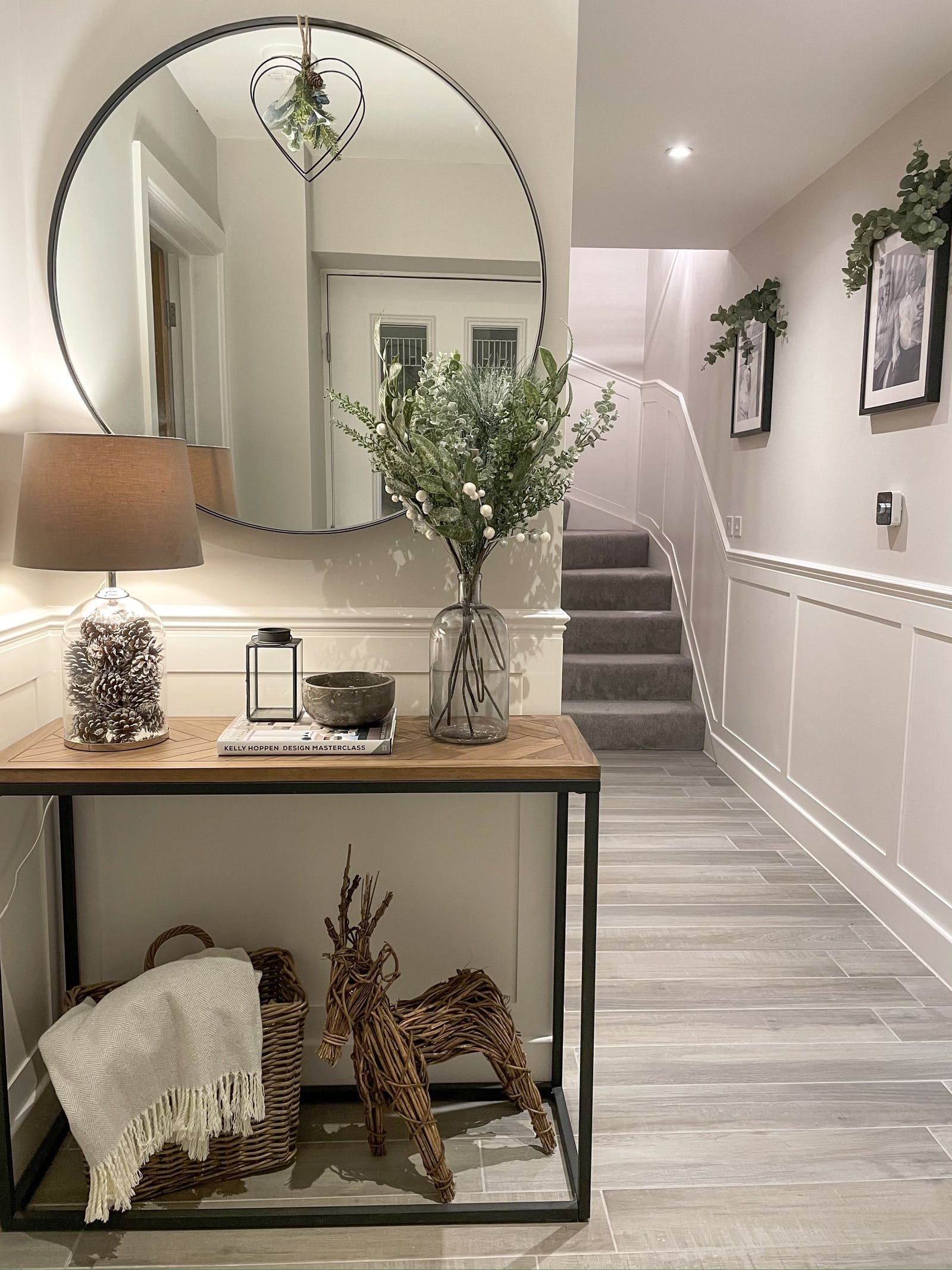 A hallway decorated in faux greenery