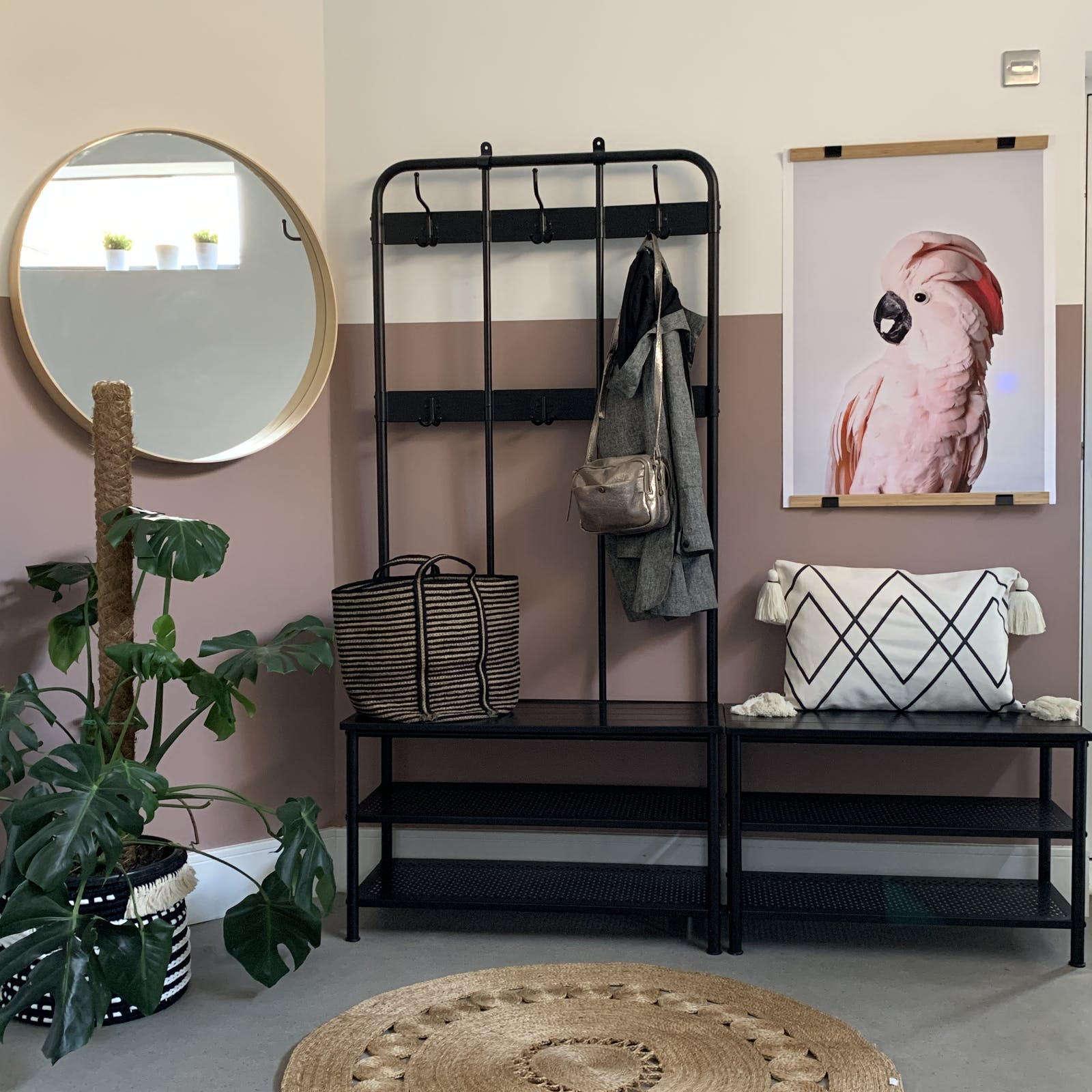 Hallway with bird print, house plant, hanging area and large circle mirror