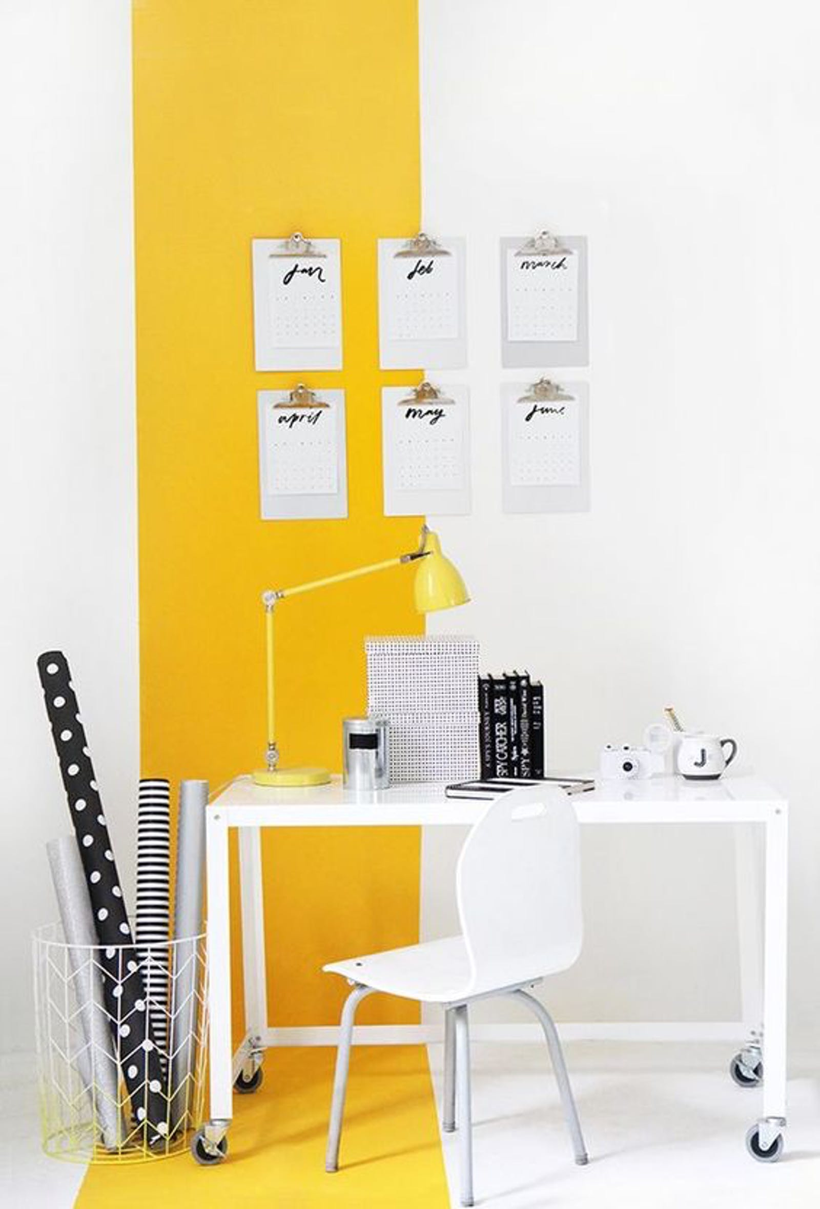 Home office area painted in yellow and white