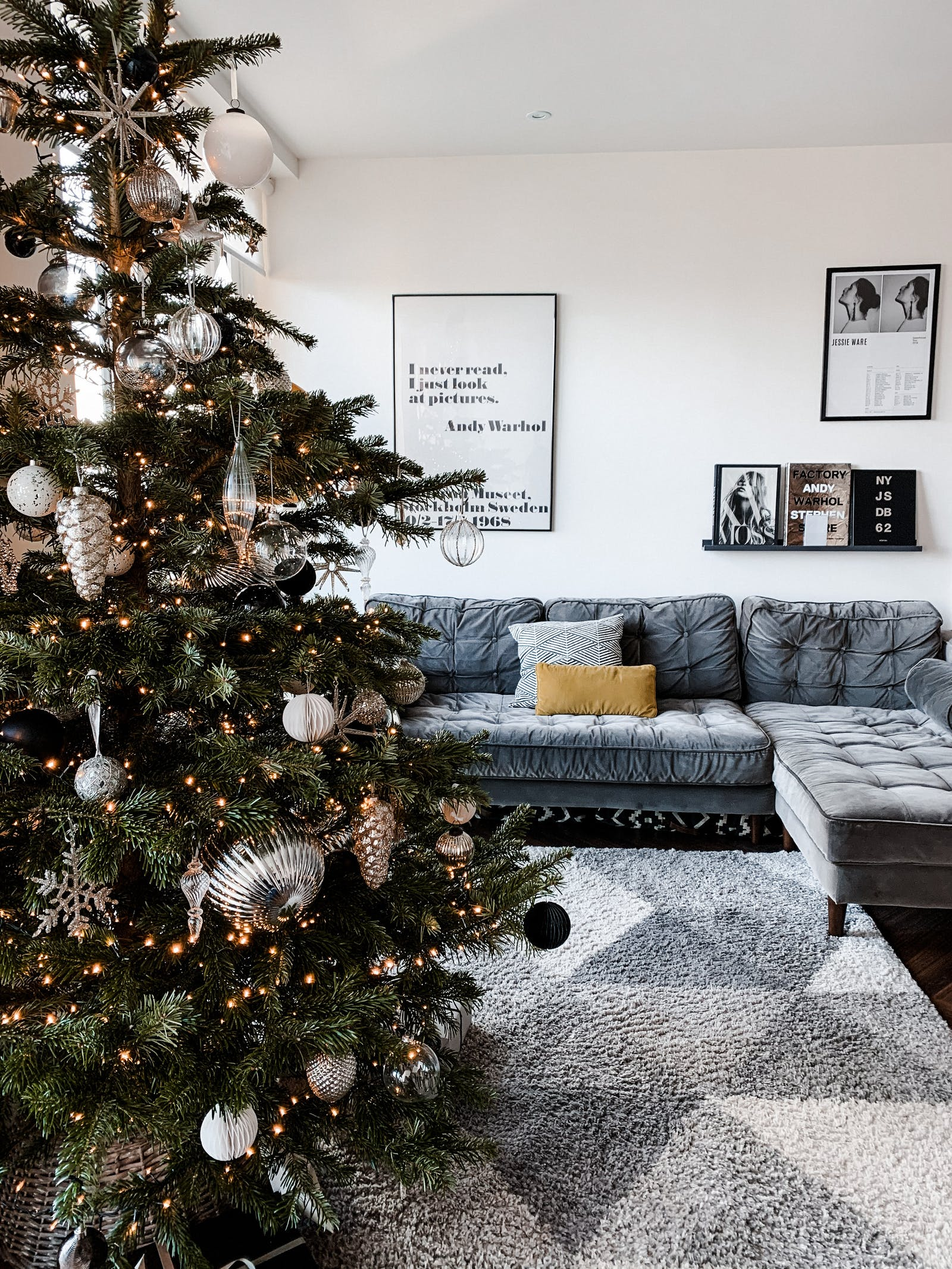 Big L shaped velvet sofa behind a Christmas tree