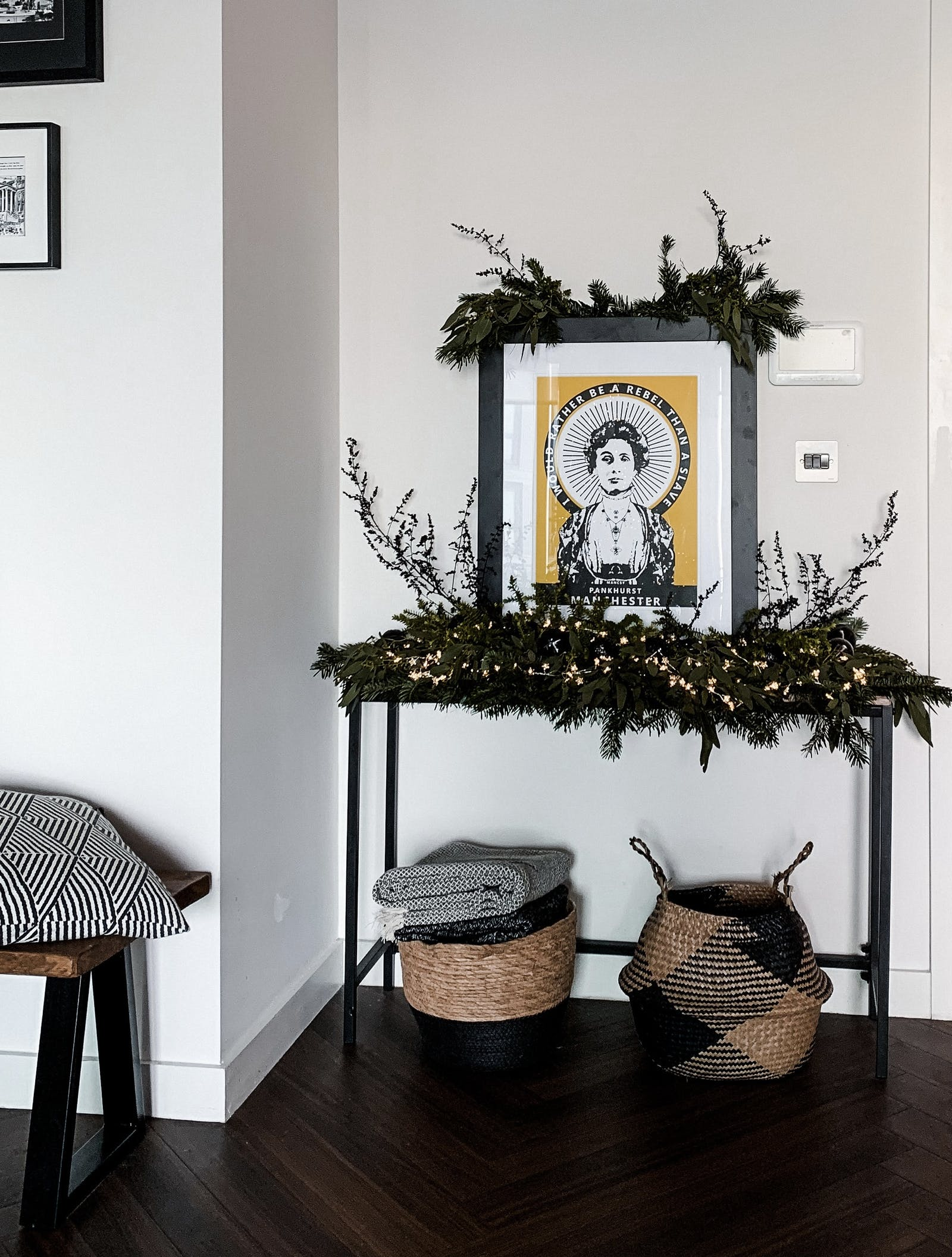Hallway console table with artwork and woven baskets