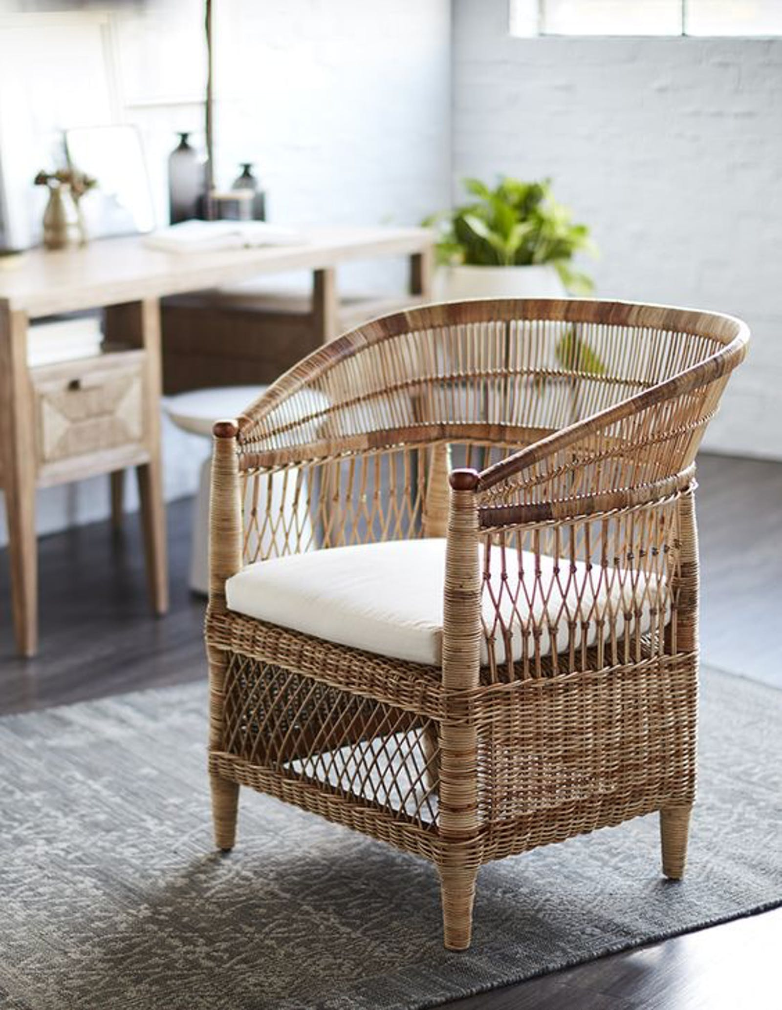 Beautiful rattan Malawian chair in a living room on a grey rug
