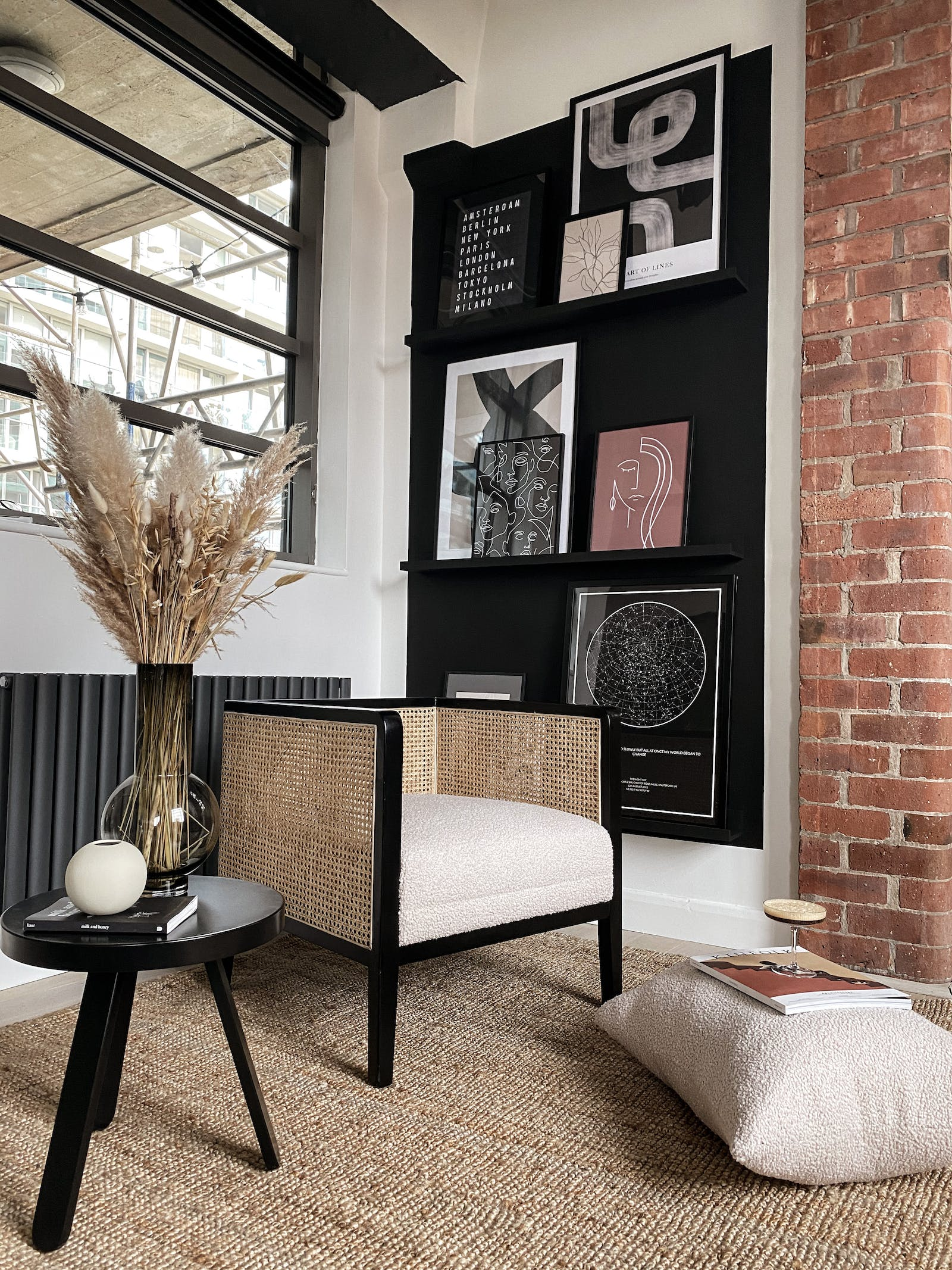 Lounge area corner with a gallery wall and exposed brick wall