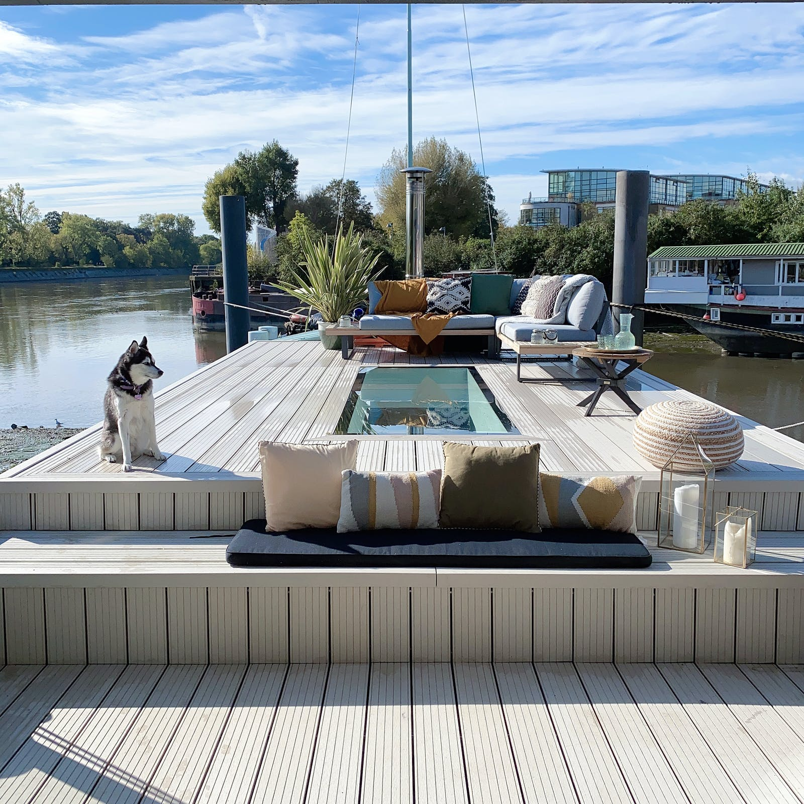 A gorgeous deck furnished with a mix of coloured cushions