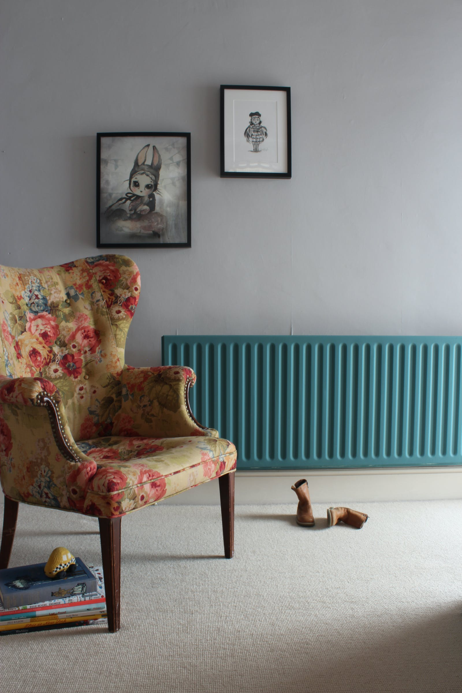 Living room with blue painted radiator and a brogue chair