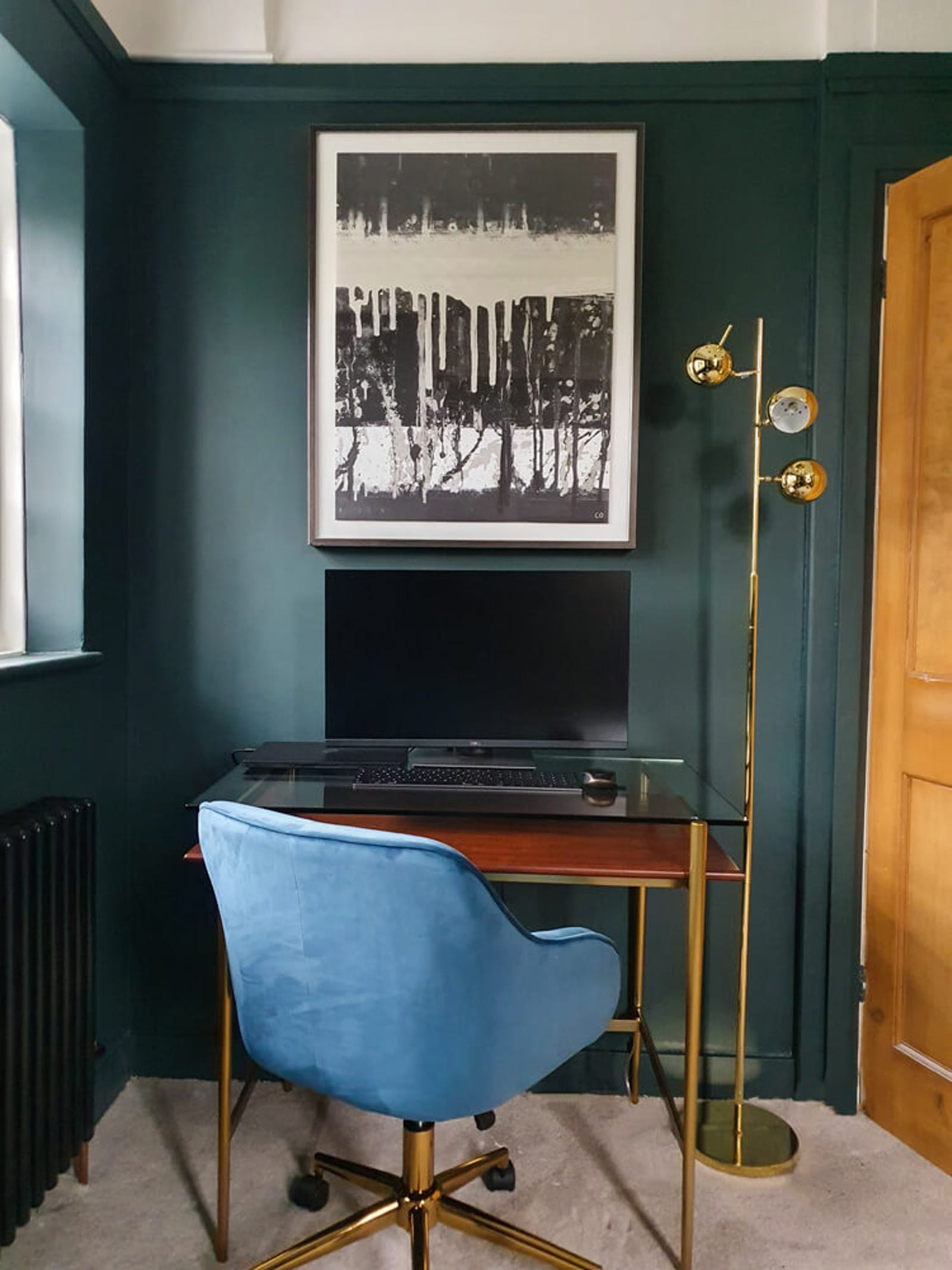 Home office with dark green walls