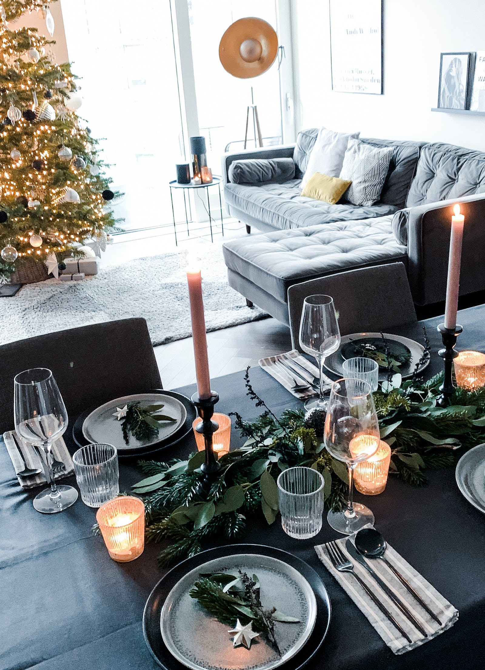Table scape with fresh foliage and candle sticks