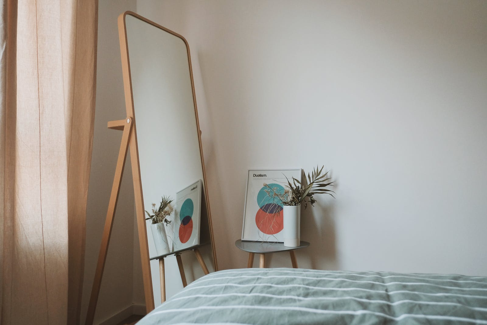 Room with white walls and standing mirror
