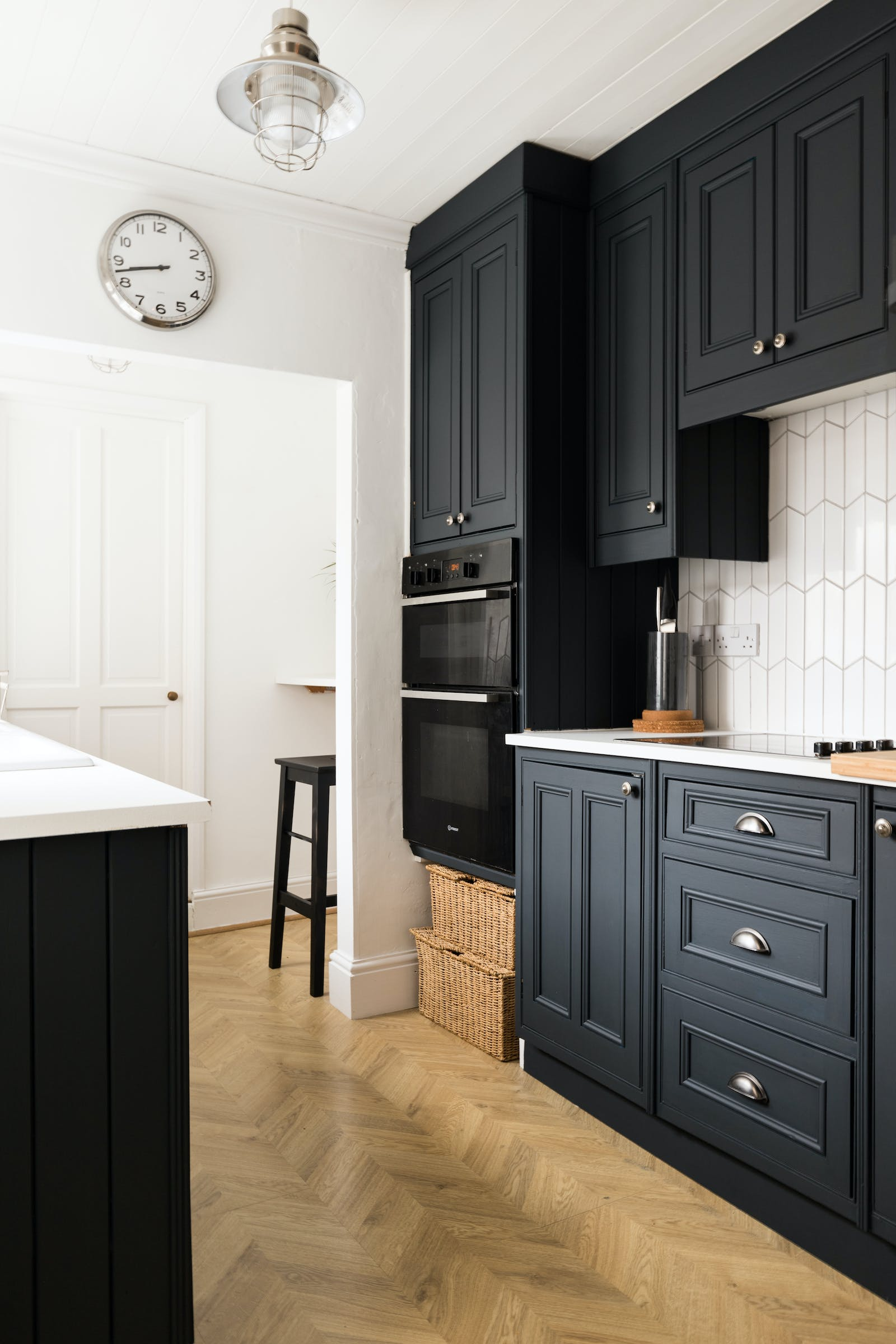 Kitchen with cabinets painted in Lick Black 01 paint