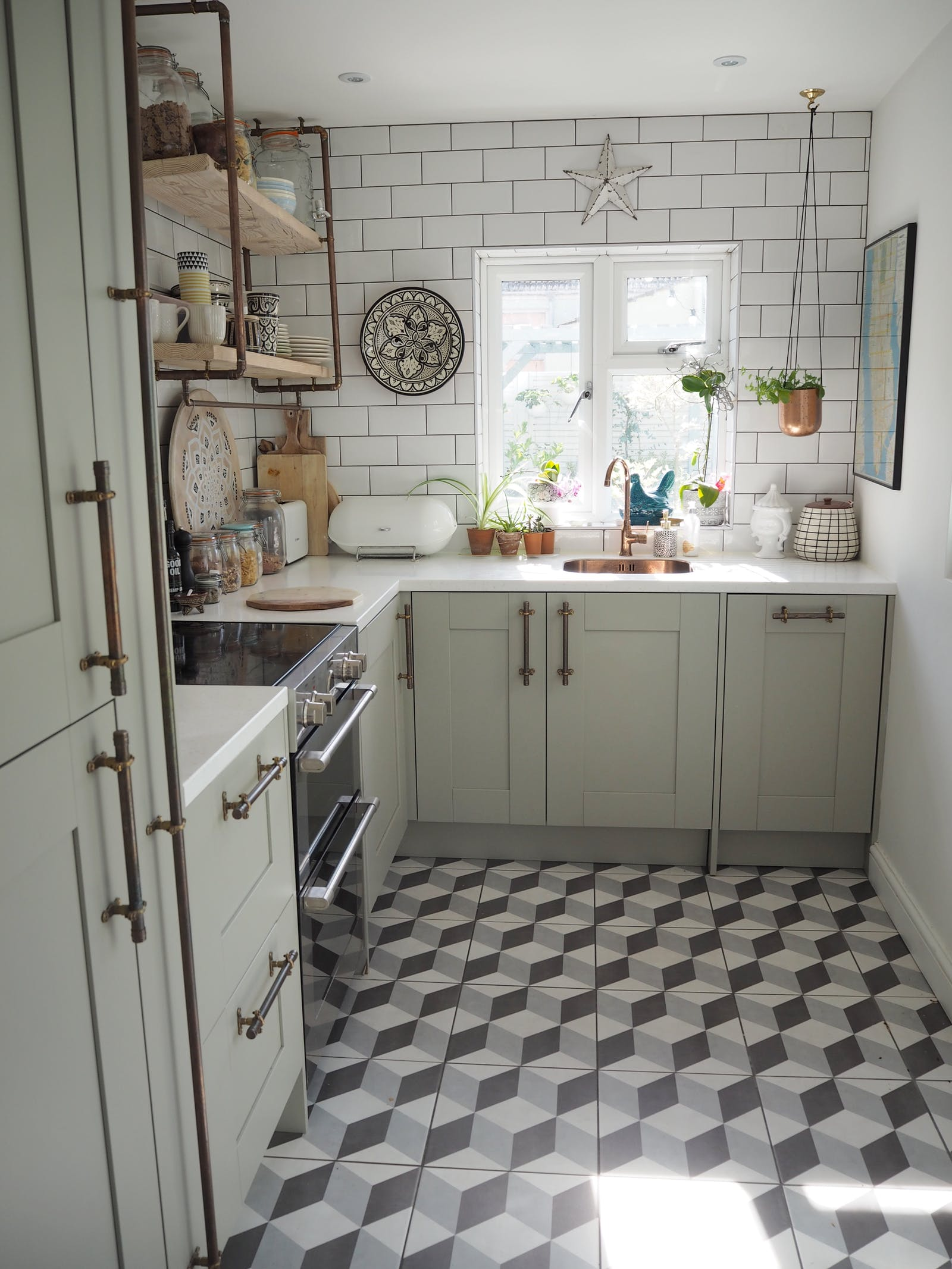 Neutral kitchen with patterned tiles on the floor and metro tiles on the wall