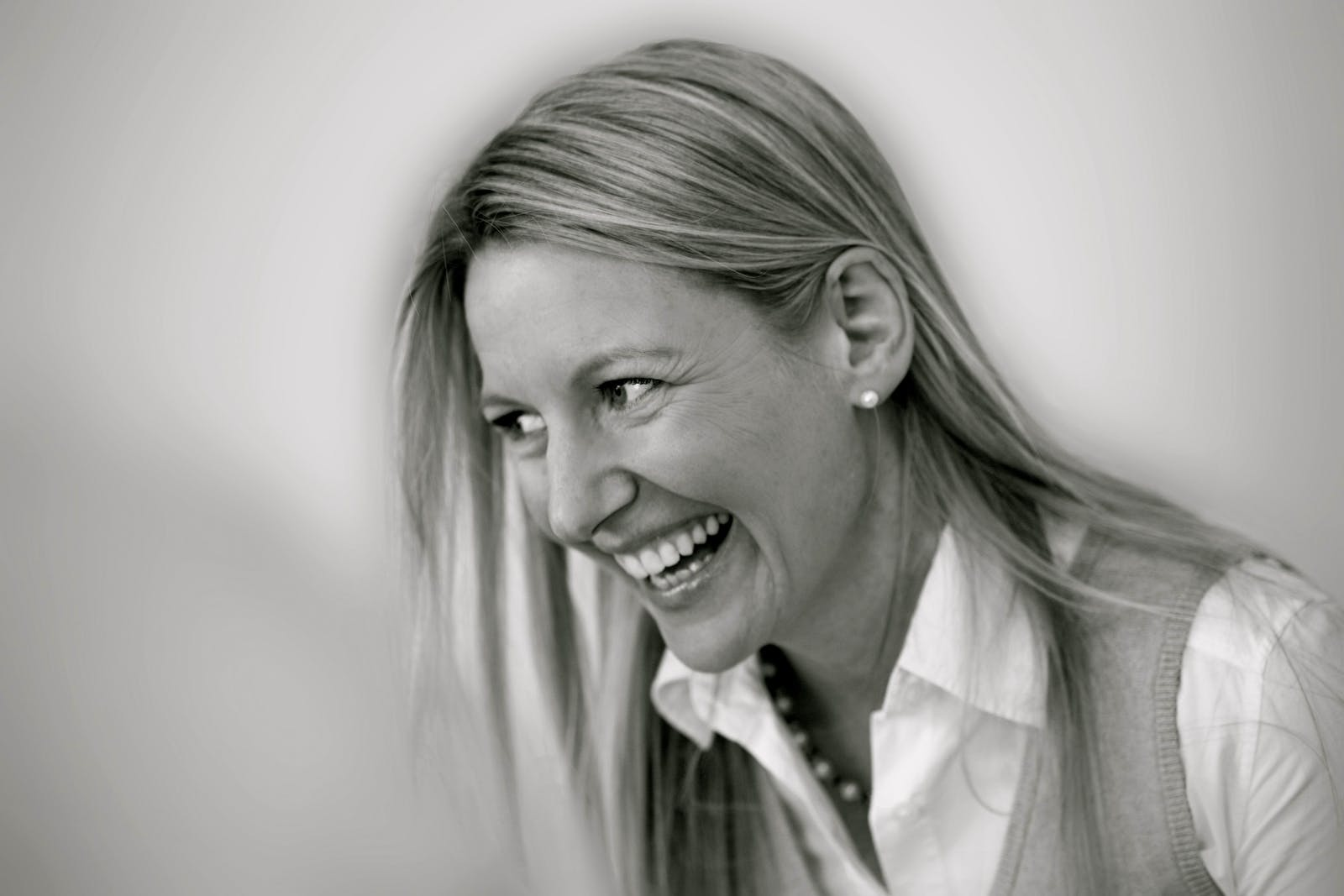 Black and white portrait of woman smiling