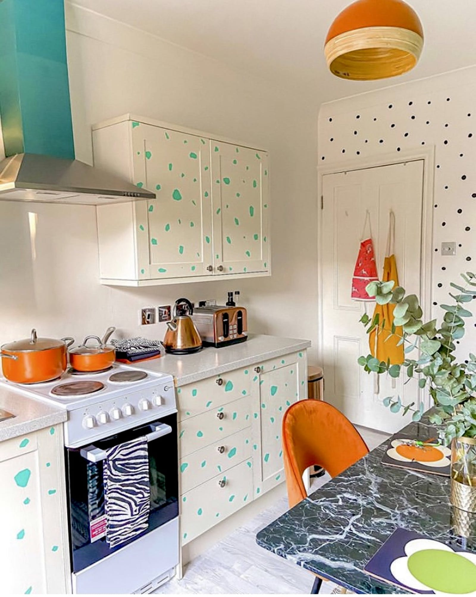 Brightly coloured kitchen with polkadot kitchen cupboards