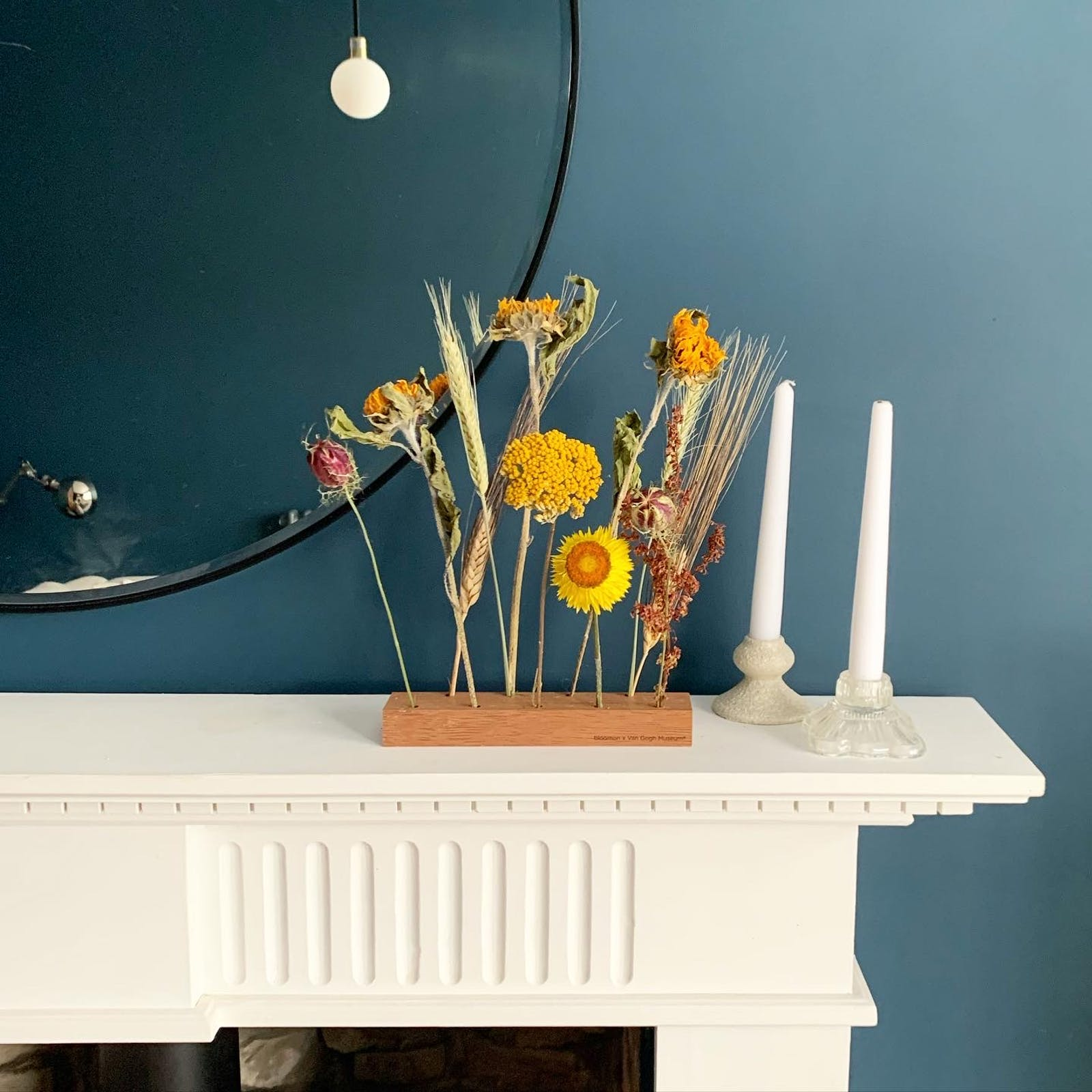 Living room with white fireplace, Lick Blue 07 walls, yellow flowers and candles