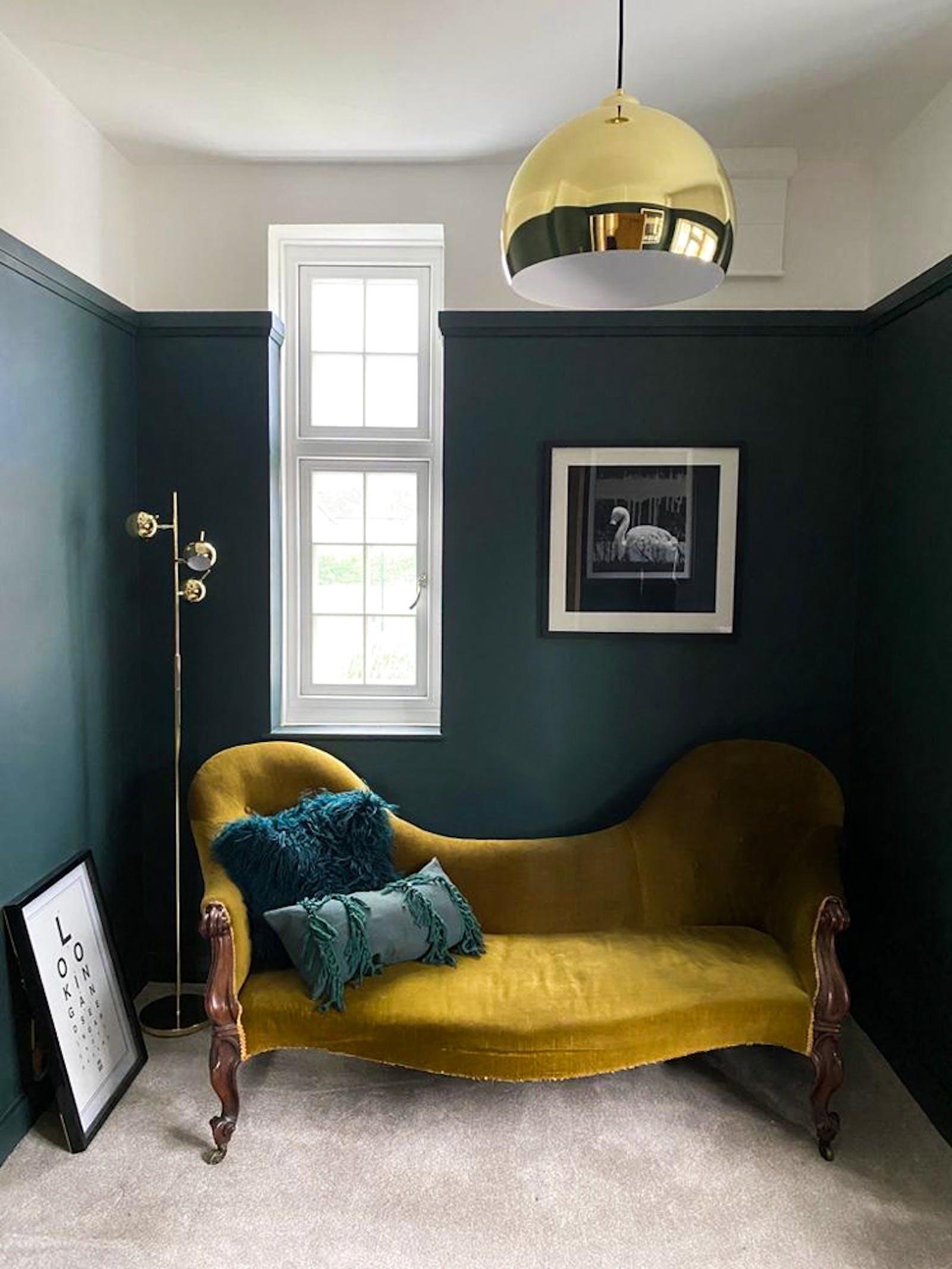 Antique dark mustard sofa in newly renovated room