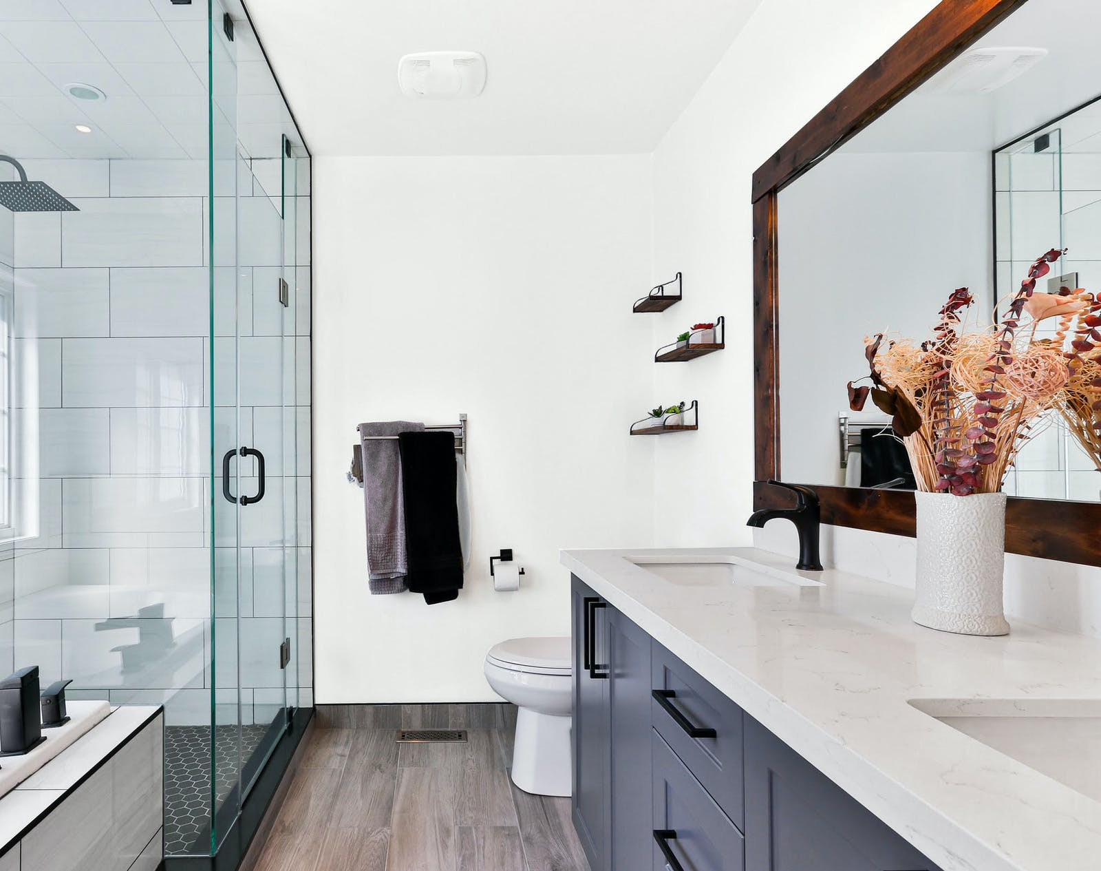 Bright and white bathroom with wooden floor, painted in Lick White 01