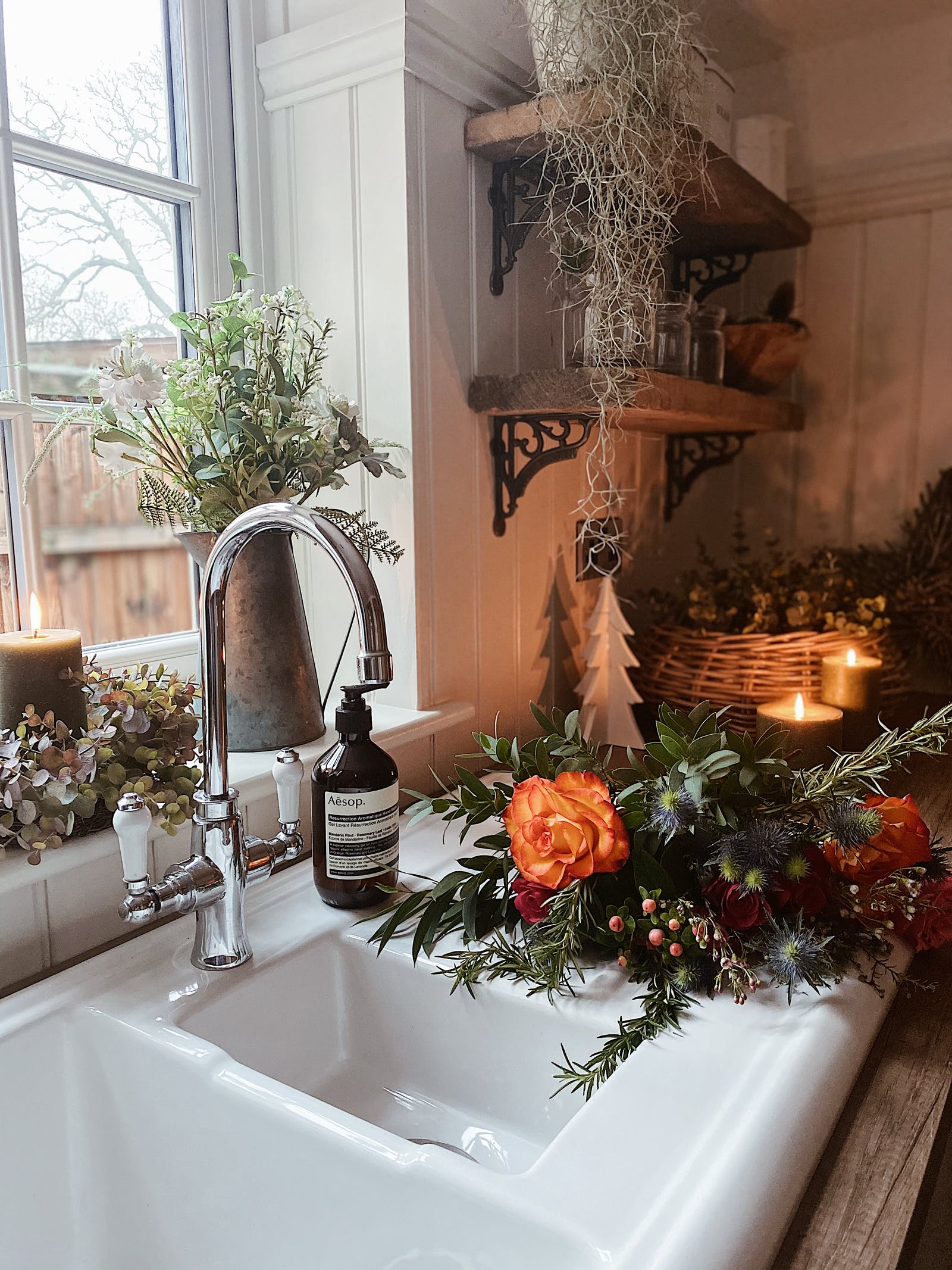 Kitchen sink with soap and fresh flowers