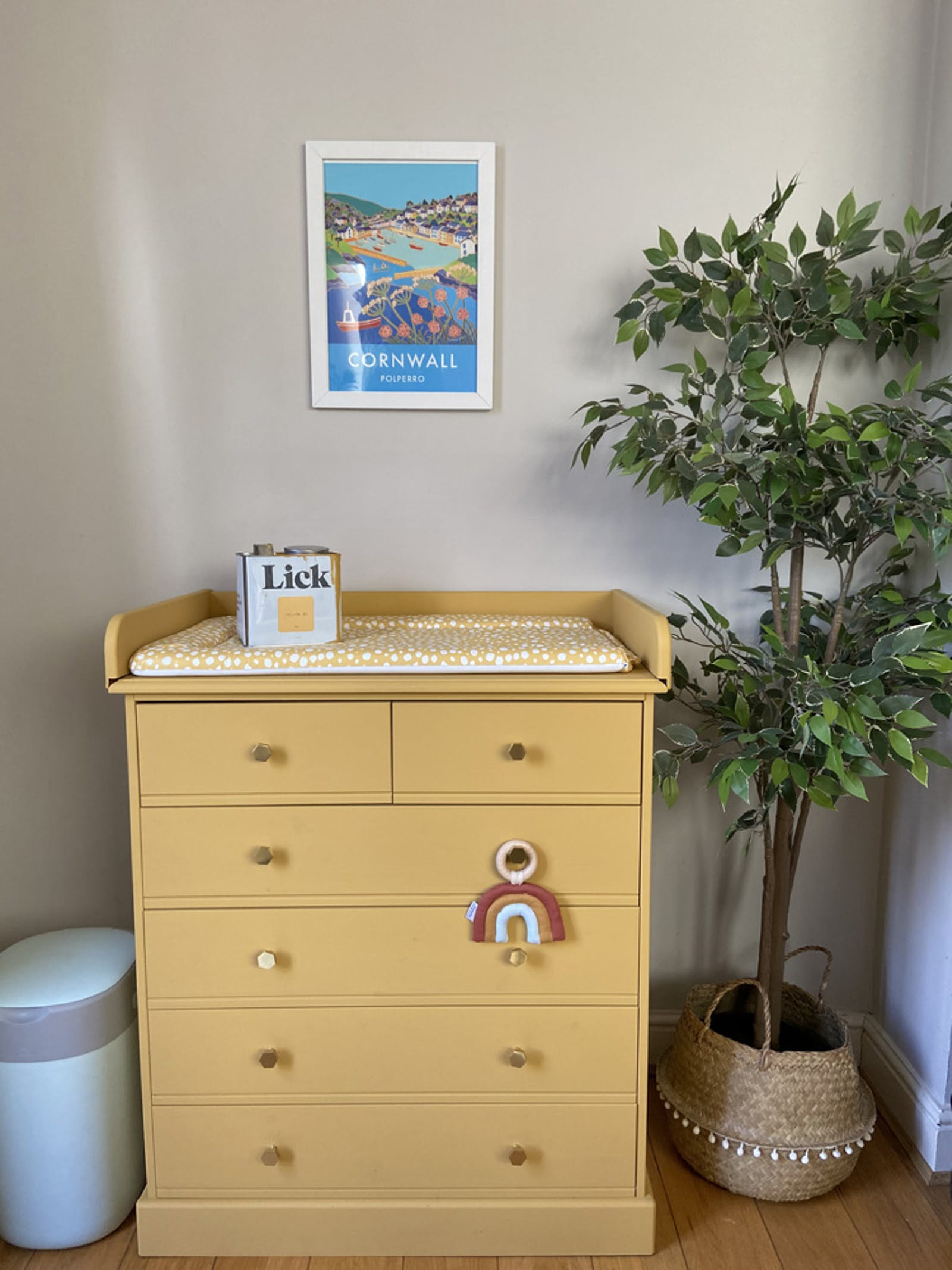 A baby changing table painted in Lick Yellow 02