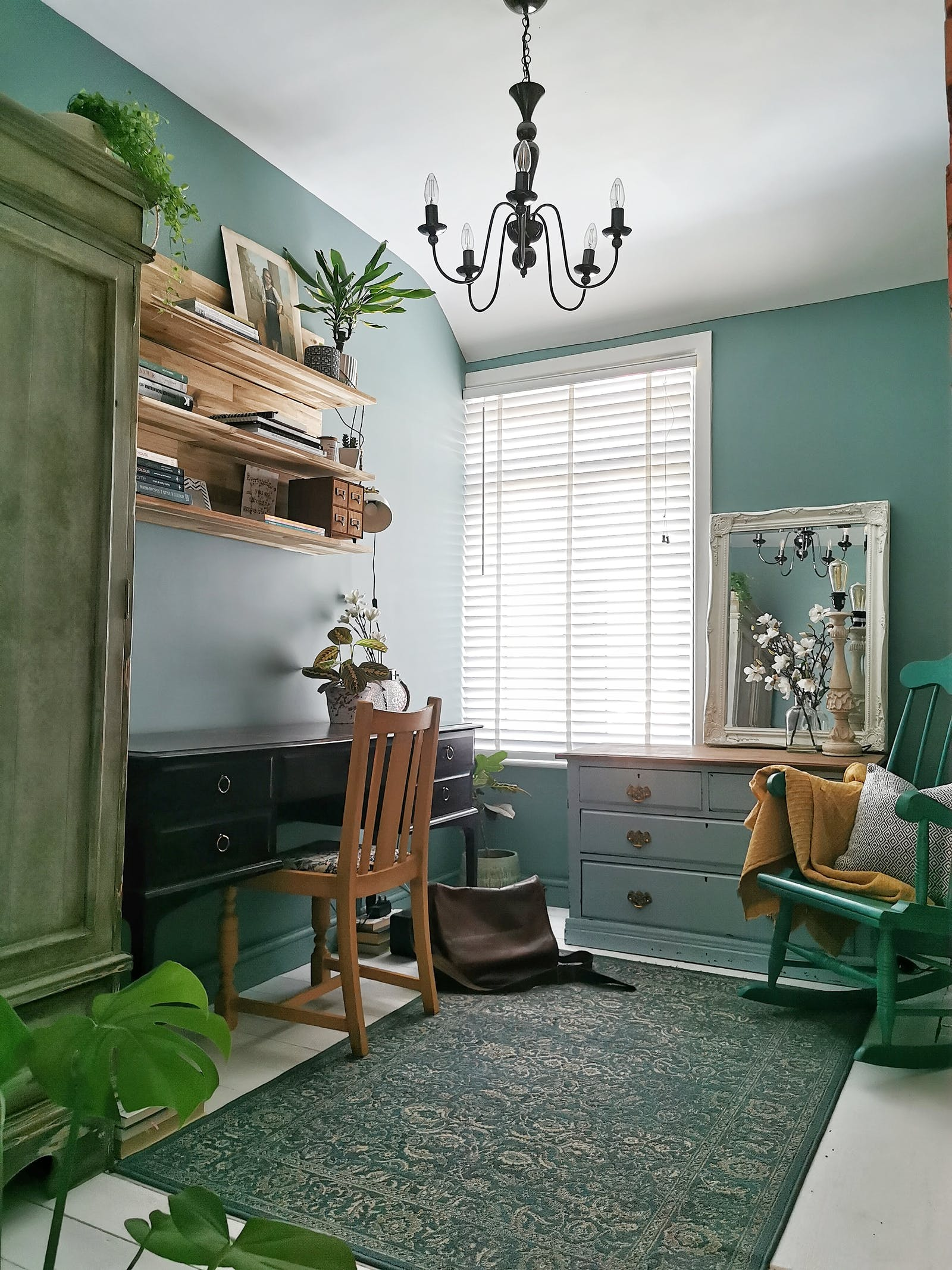 Home office painted in our Teal 01, decorated with wooden chairs and vintage furniture