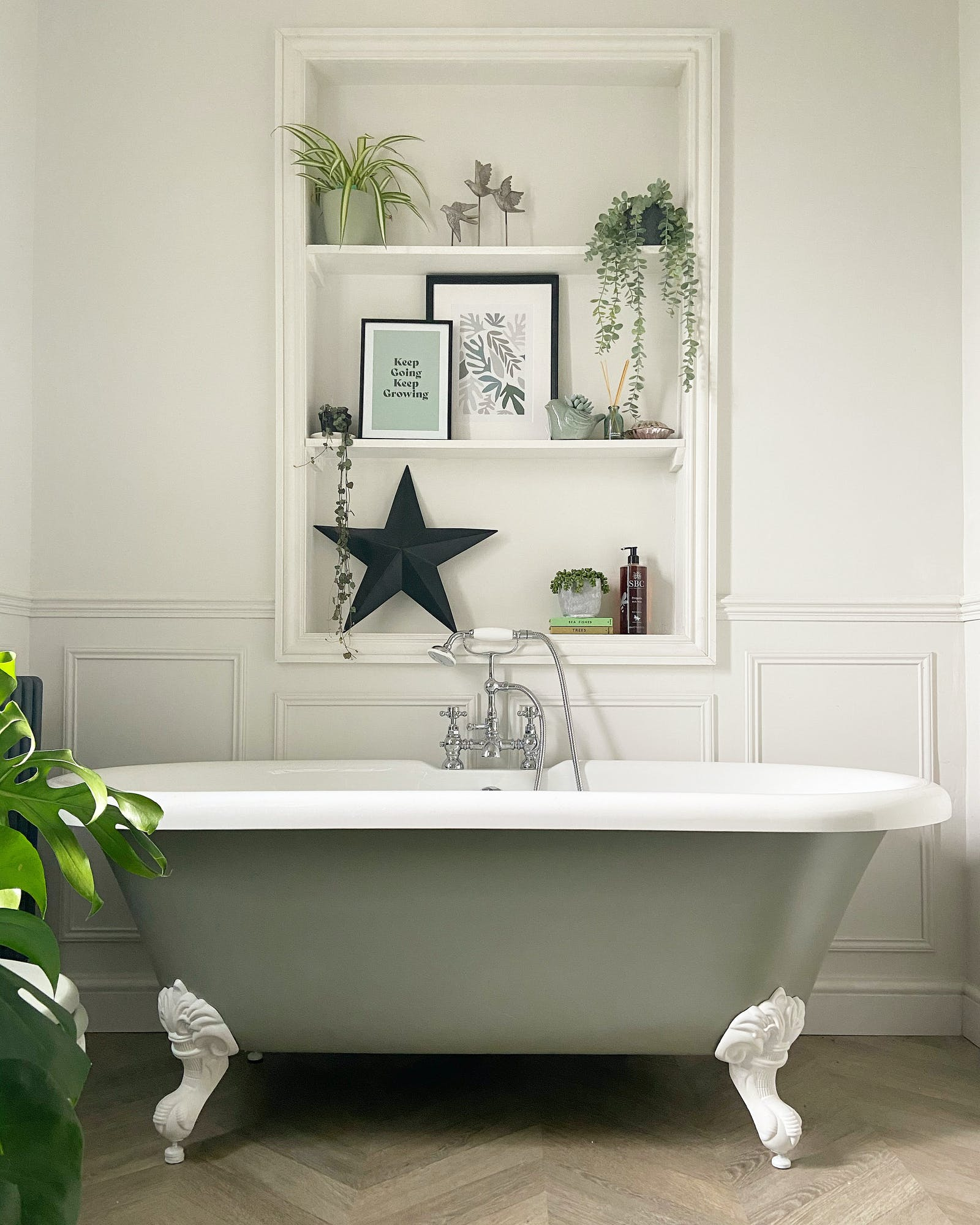 Elegant bathtub in bathroom with walls painted in Lick White 04