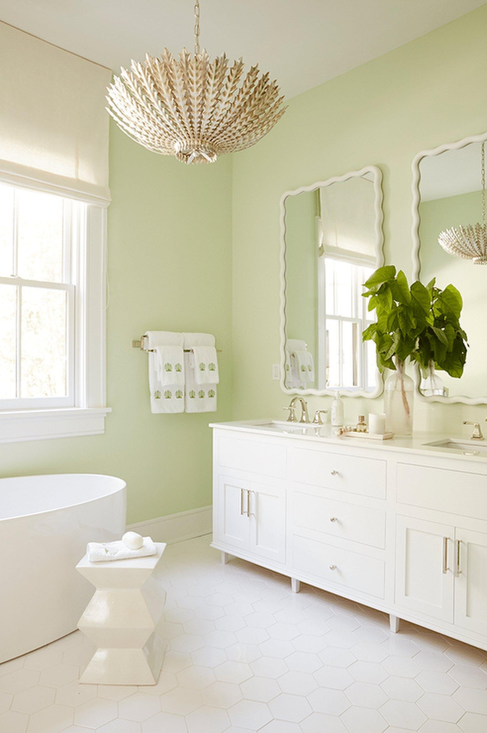 Vintage bathroom in light pastel green colour