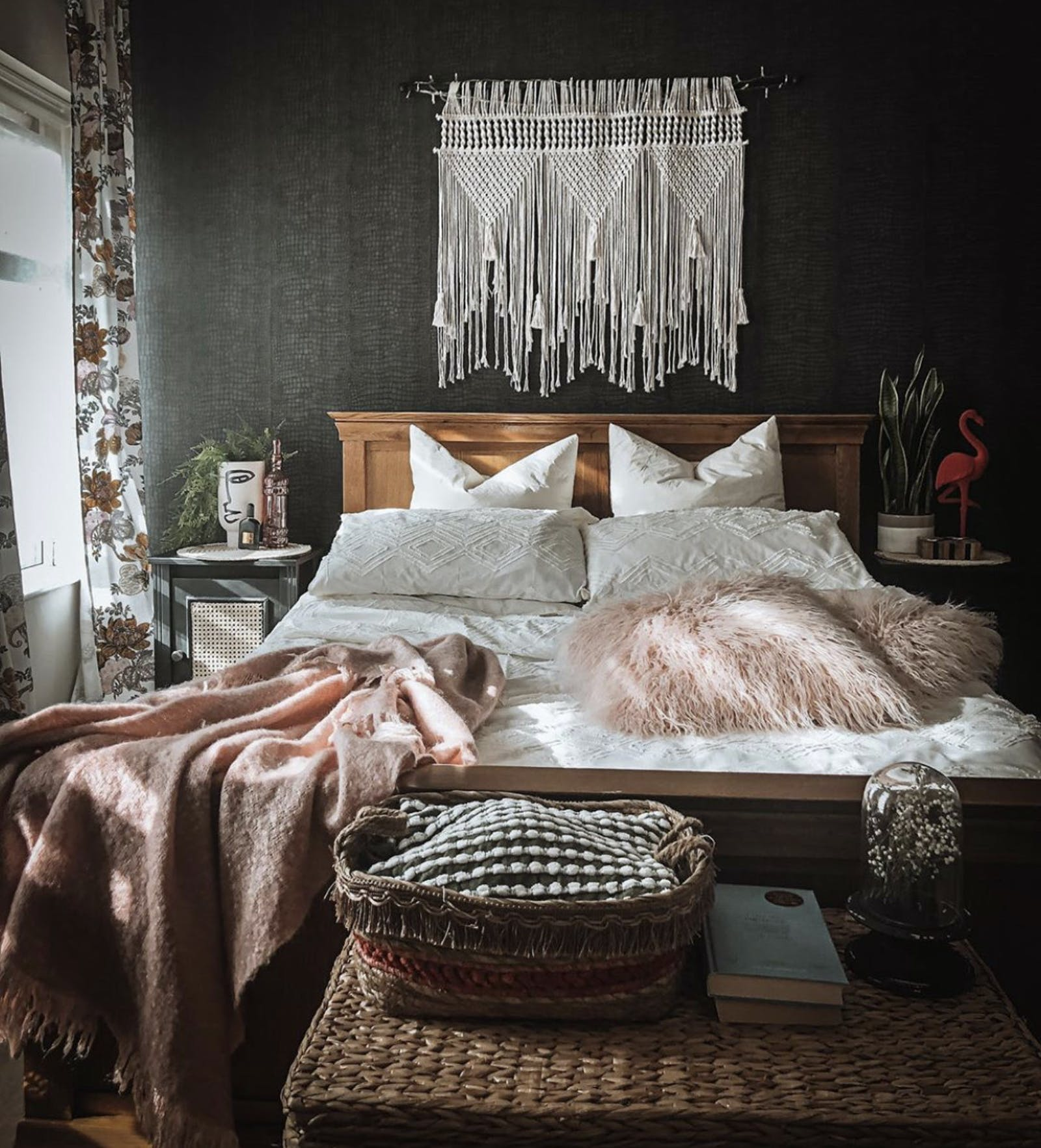 Boho bedroom in dark colours with a lot of textures