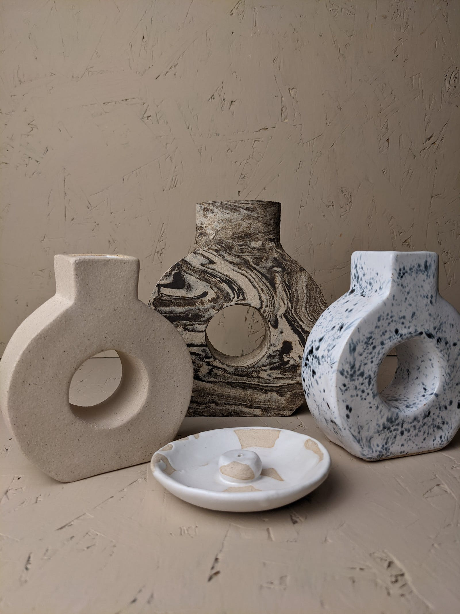 An assortment of vases with unique prints on them