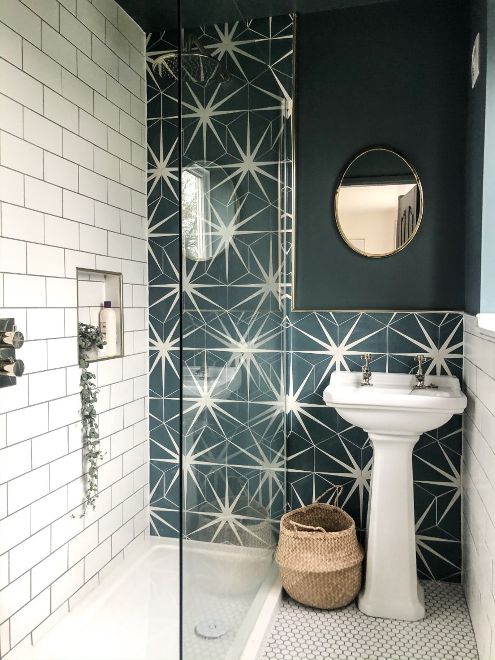 Ensuite painted in teal colour with pattern tiles