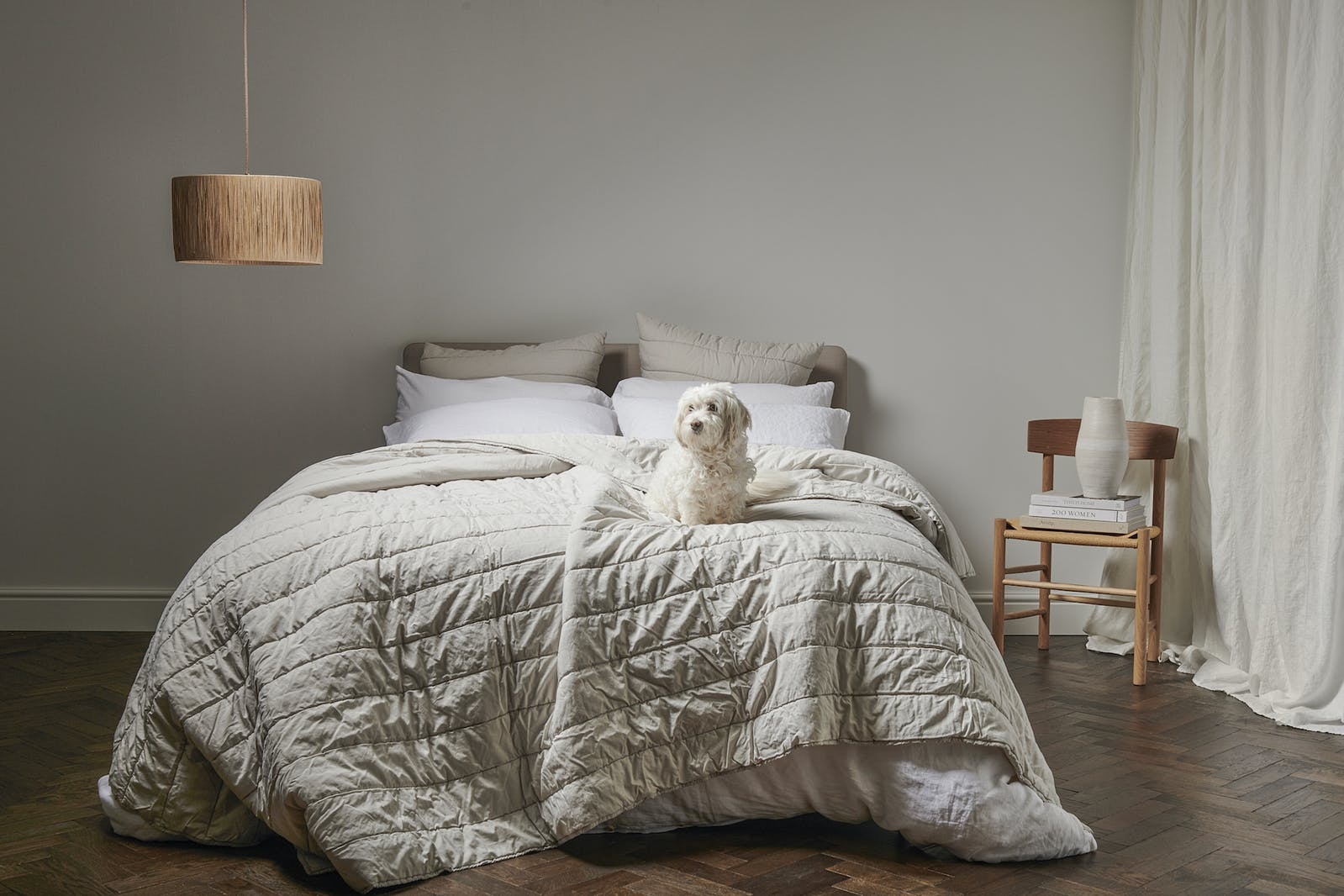 Bedfolk layered bedding in a beige and calming room setting