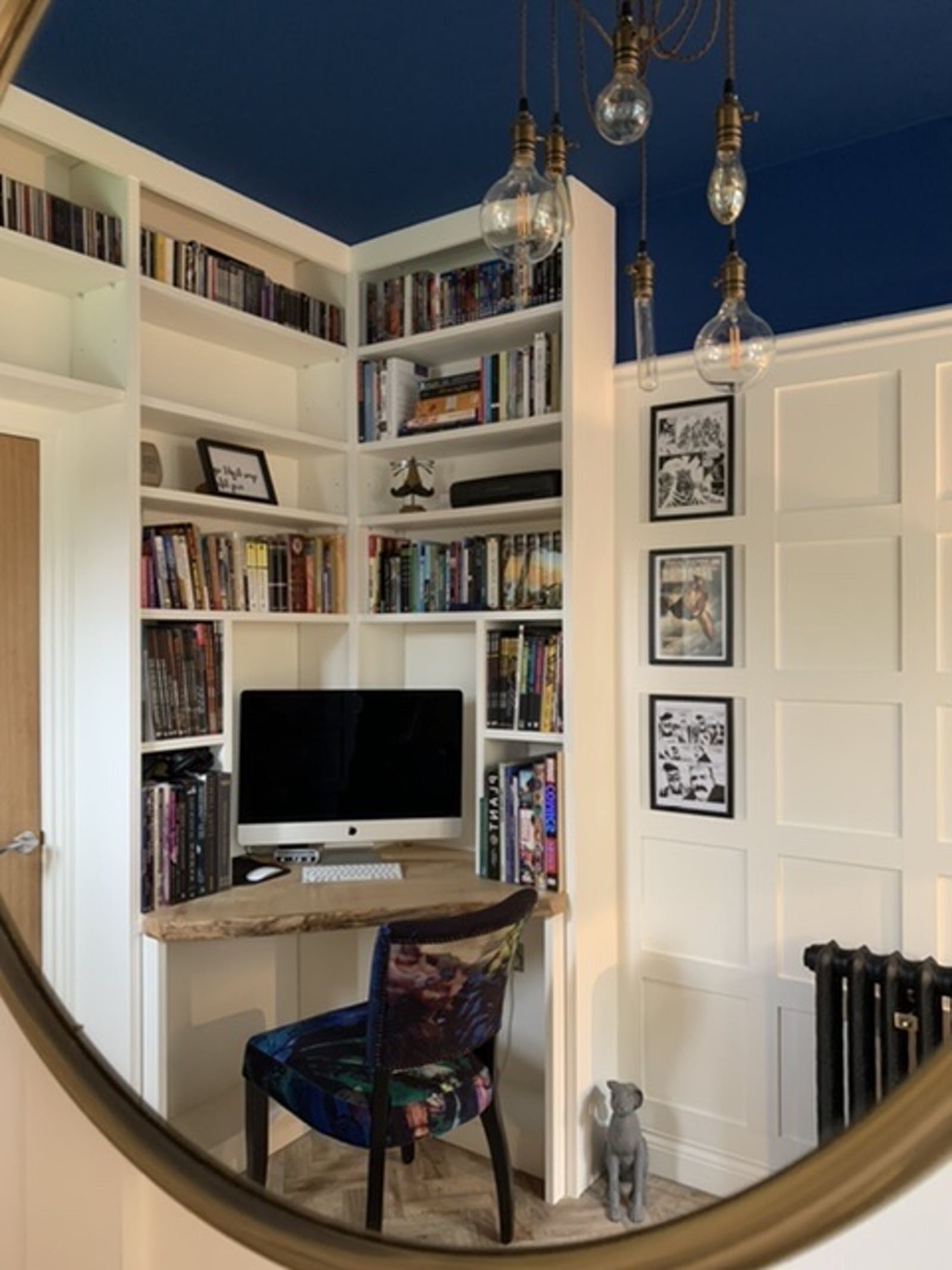 White bookshelf and ceiling painted in Lick Blue 111