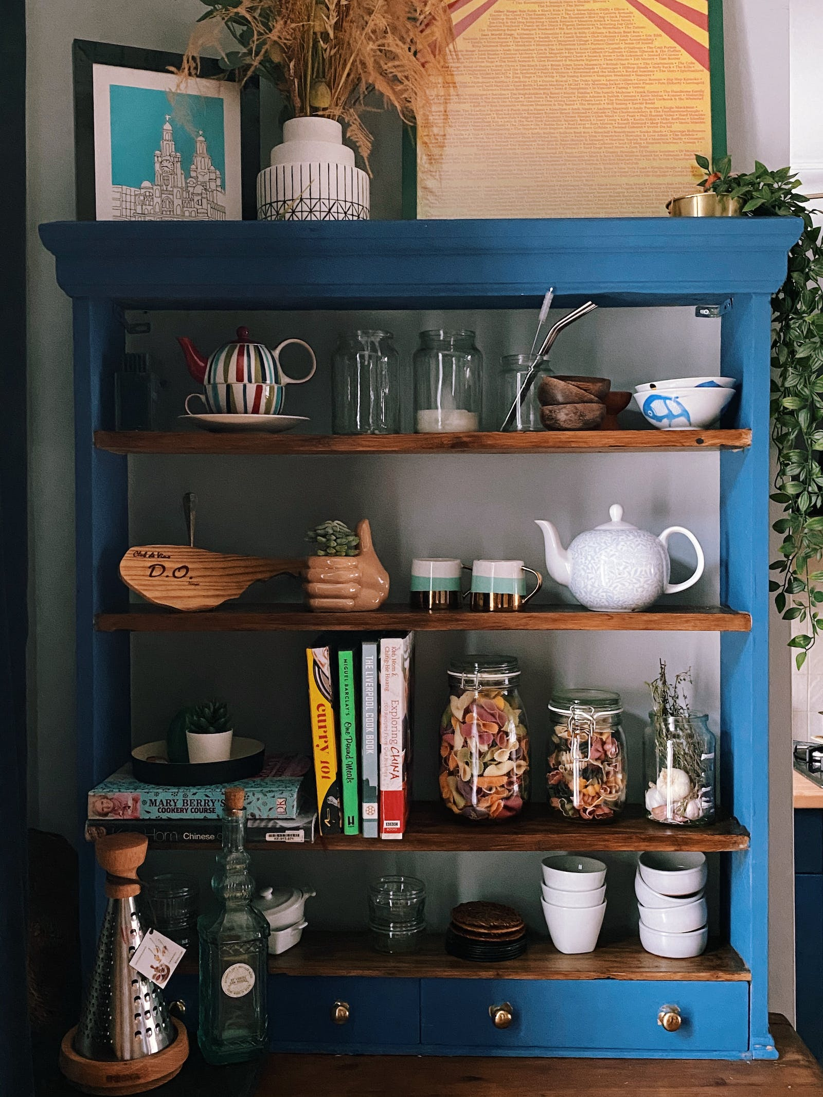 Vintage cupboard painted in blue with kitchen details