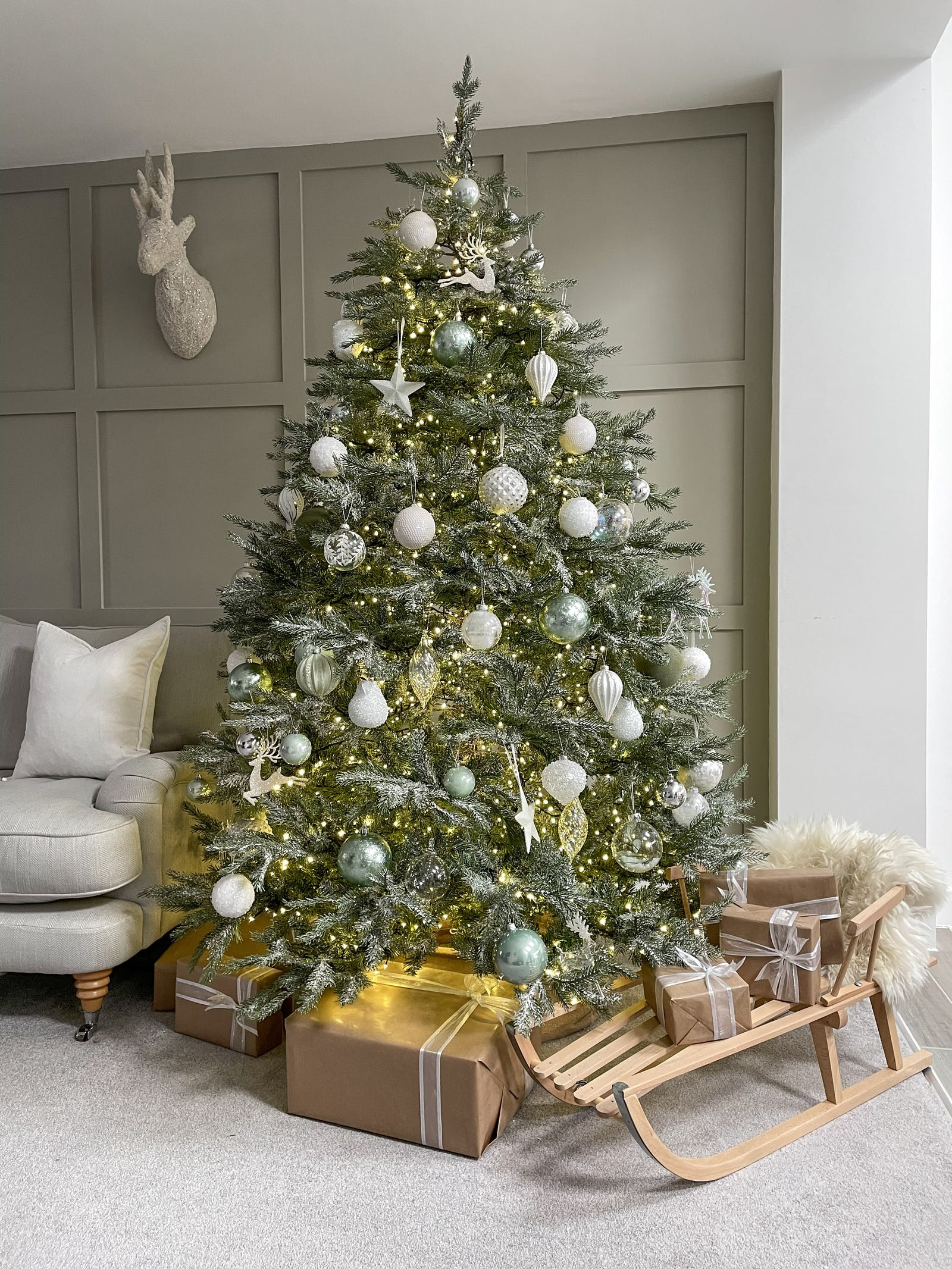 Large Christmas tree decorated in pale blue and white baubles
