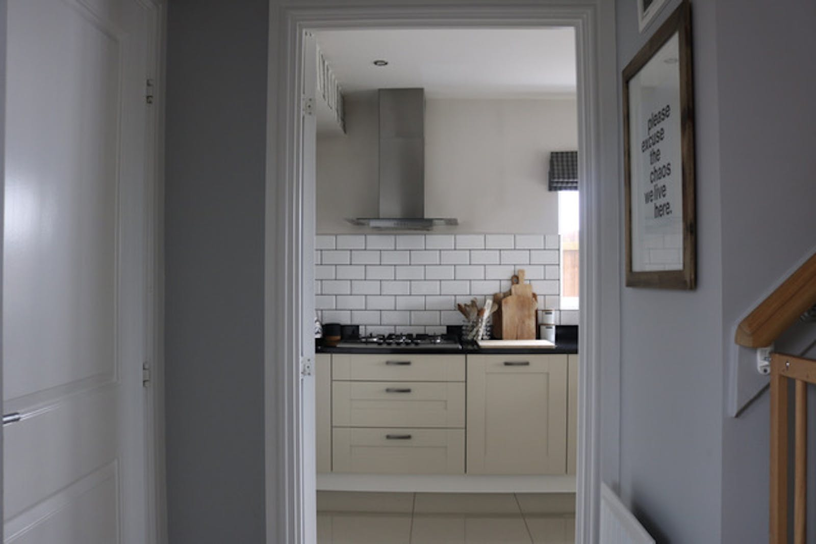 A view of a brightly coloured kitchen through a doorframe