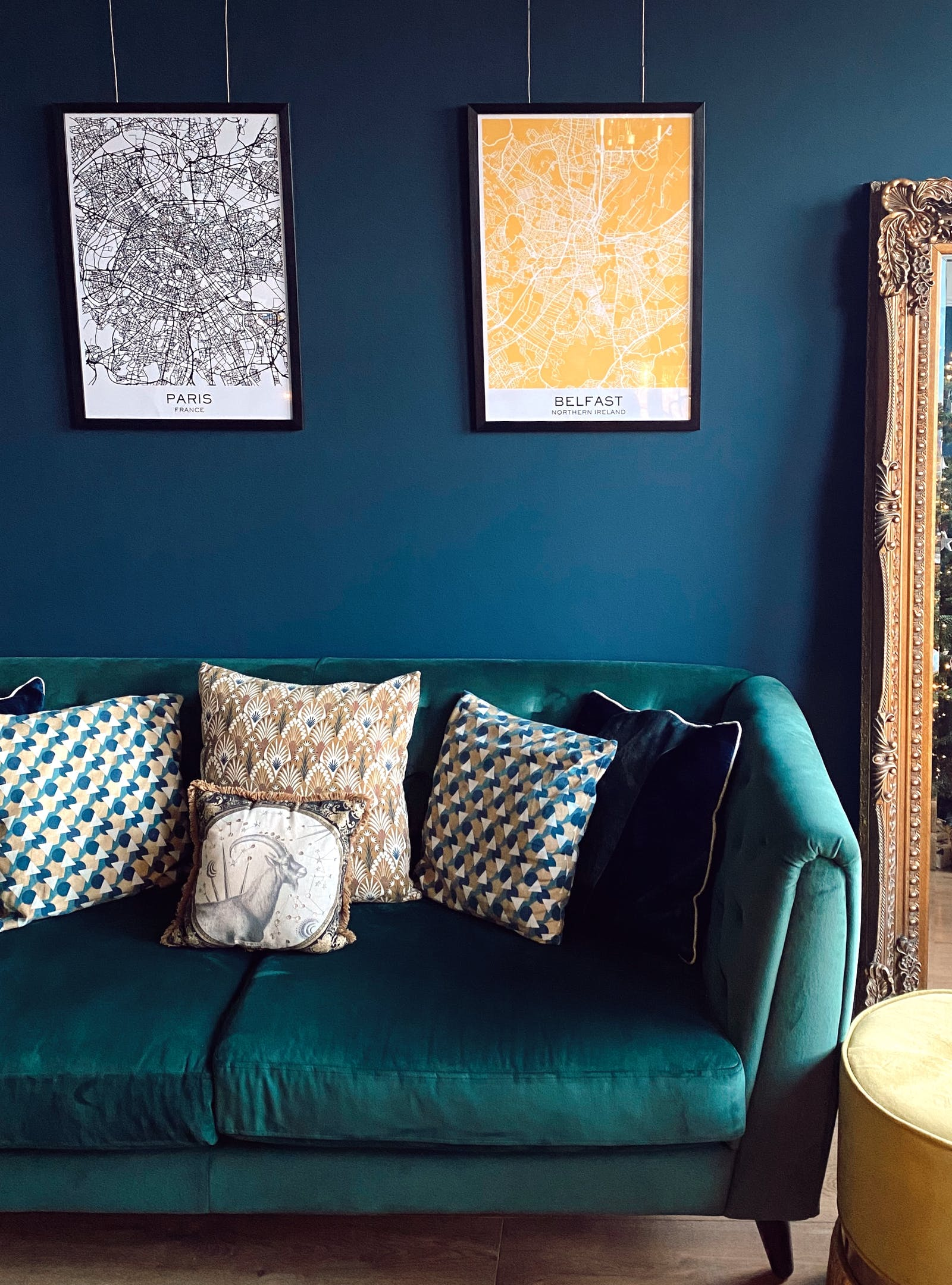 Living room with velvet green sofa, Lick Blue 07 walls and splashes of yellow accents