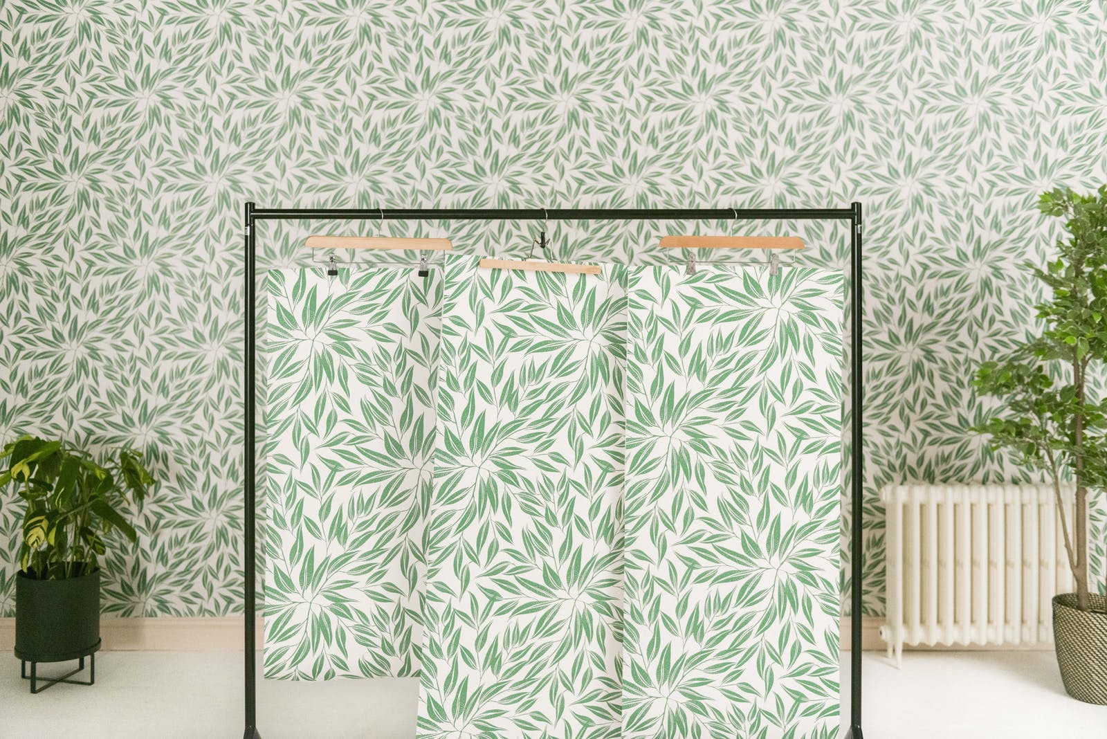 Clothes rail with botanical Lick wallpapers hanging on hangers