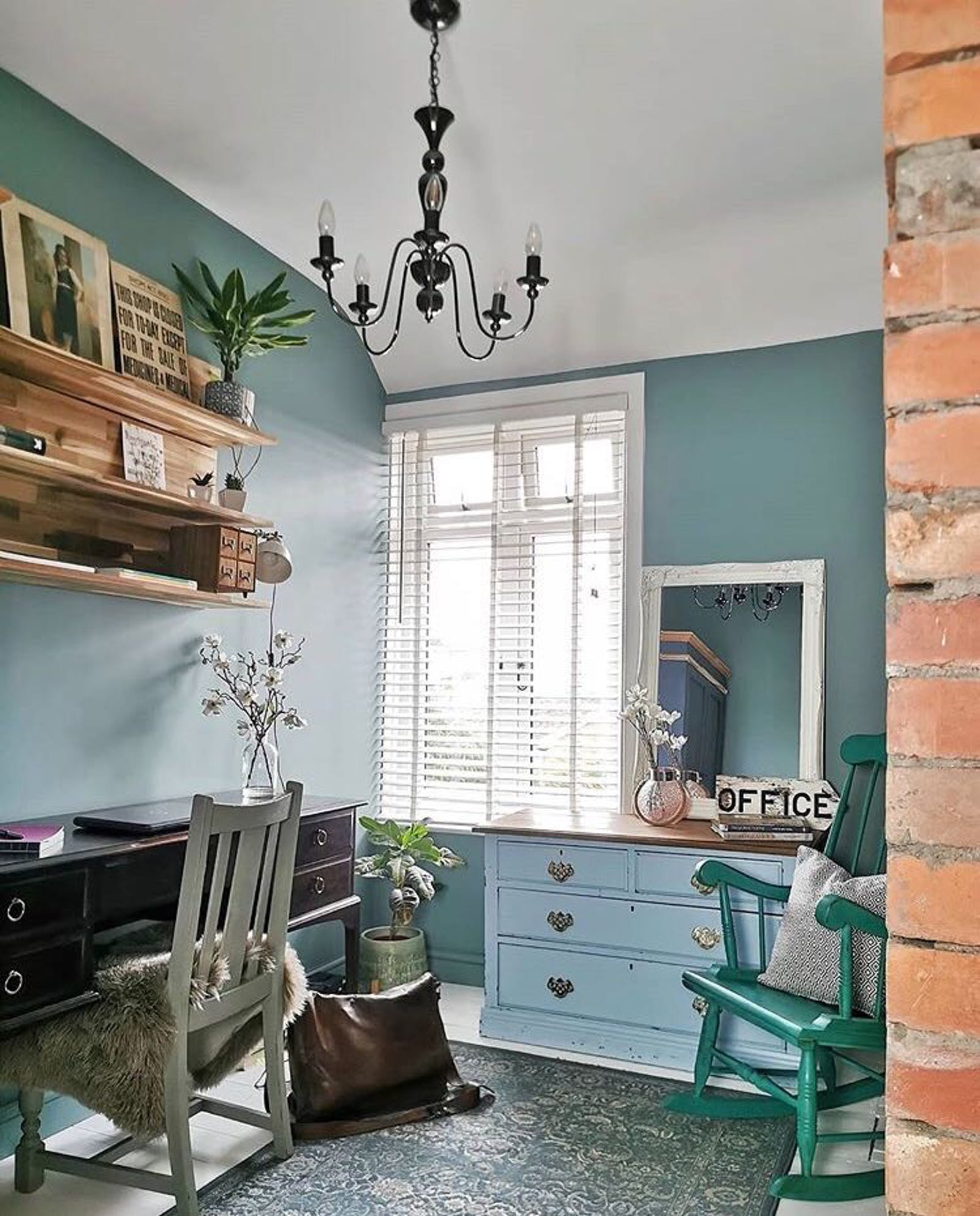 A freshly decorated study in Lick Teal 01 with vintage furniture and natural light coming in from the window