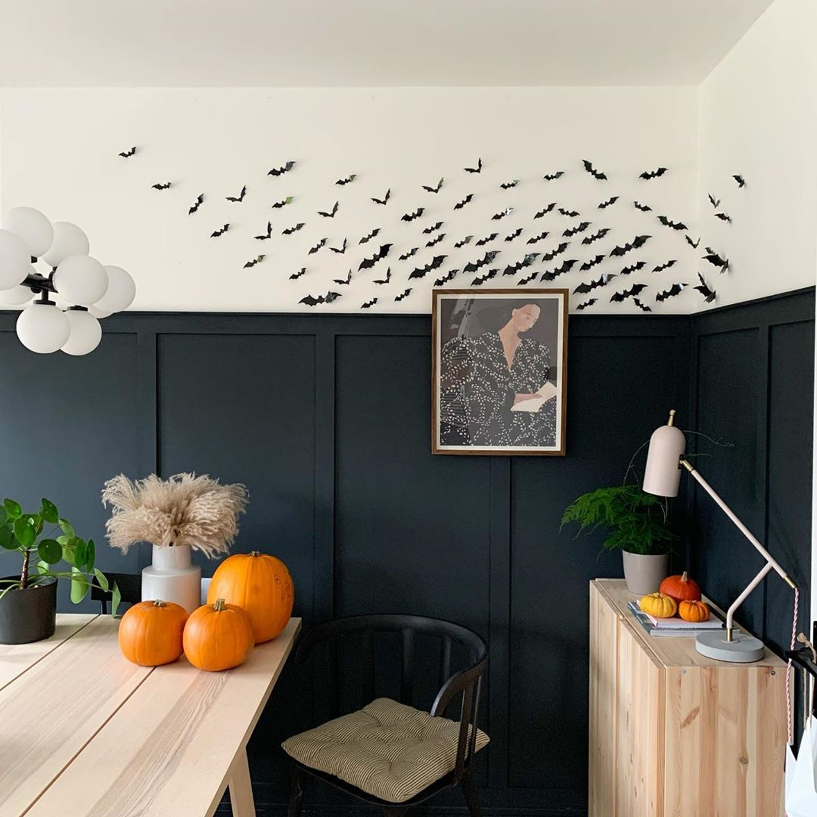 Handcrafted bats on a wall painted in Lick Blue 07