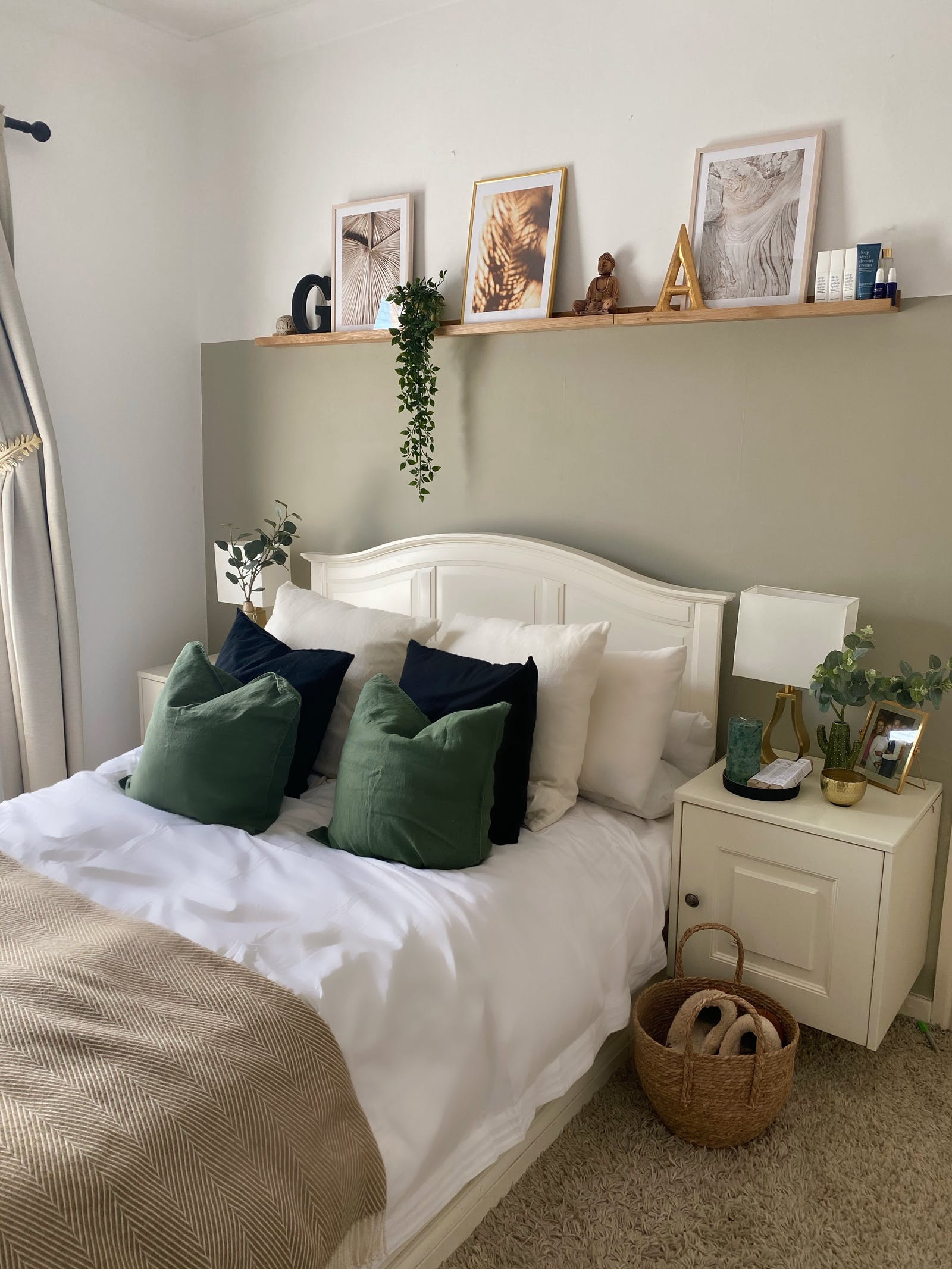 Bedroom in white with a feature wall in light sage green