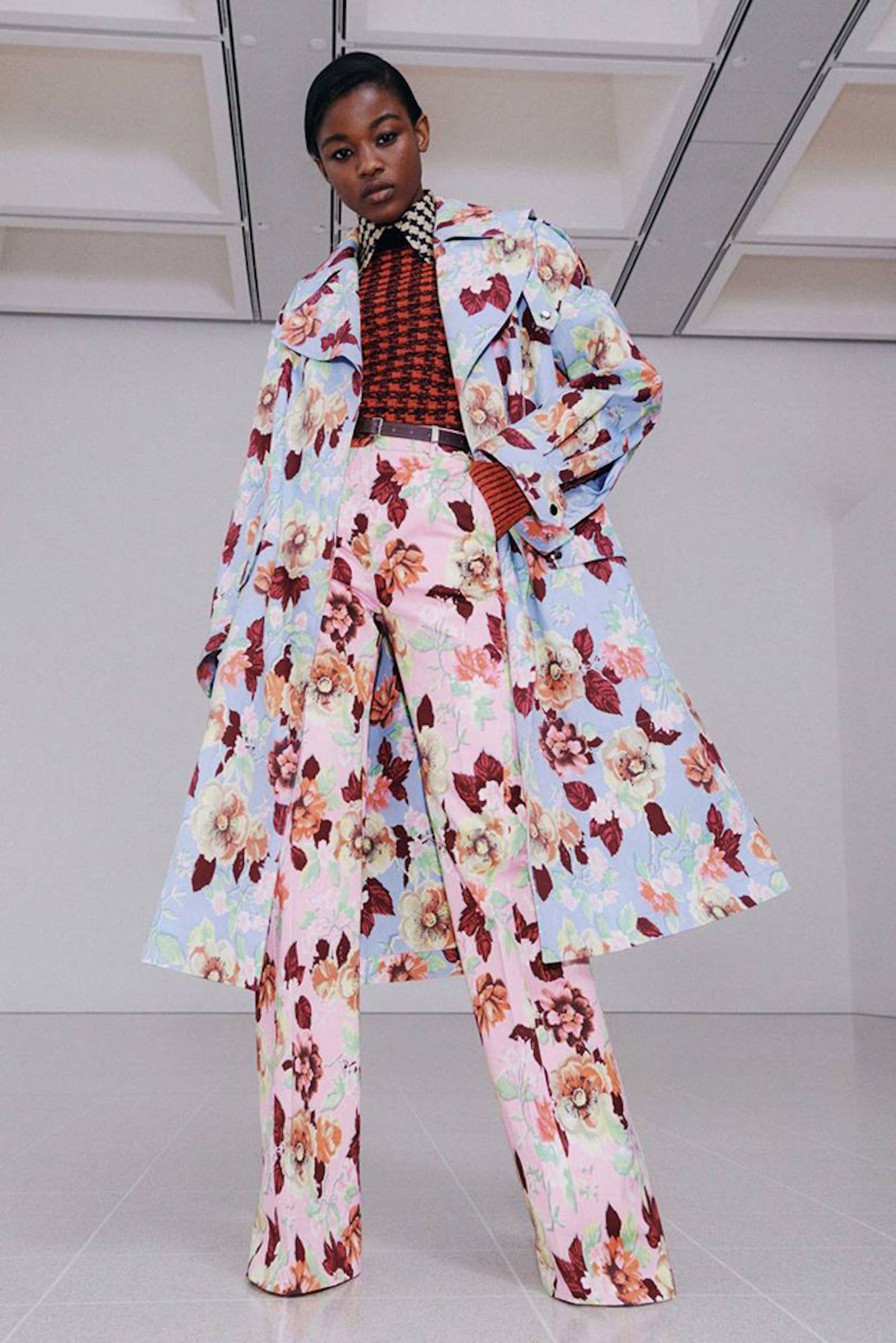 London fashion week shot of woman wearing loud floral and geometric patterned outfit