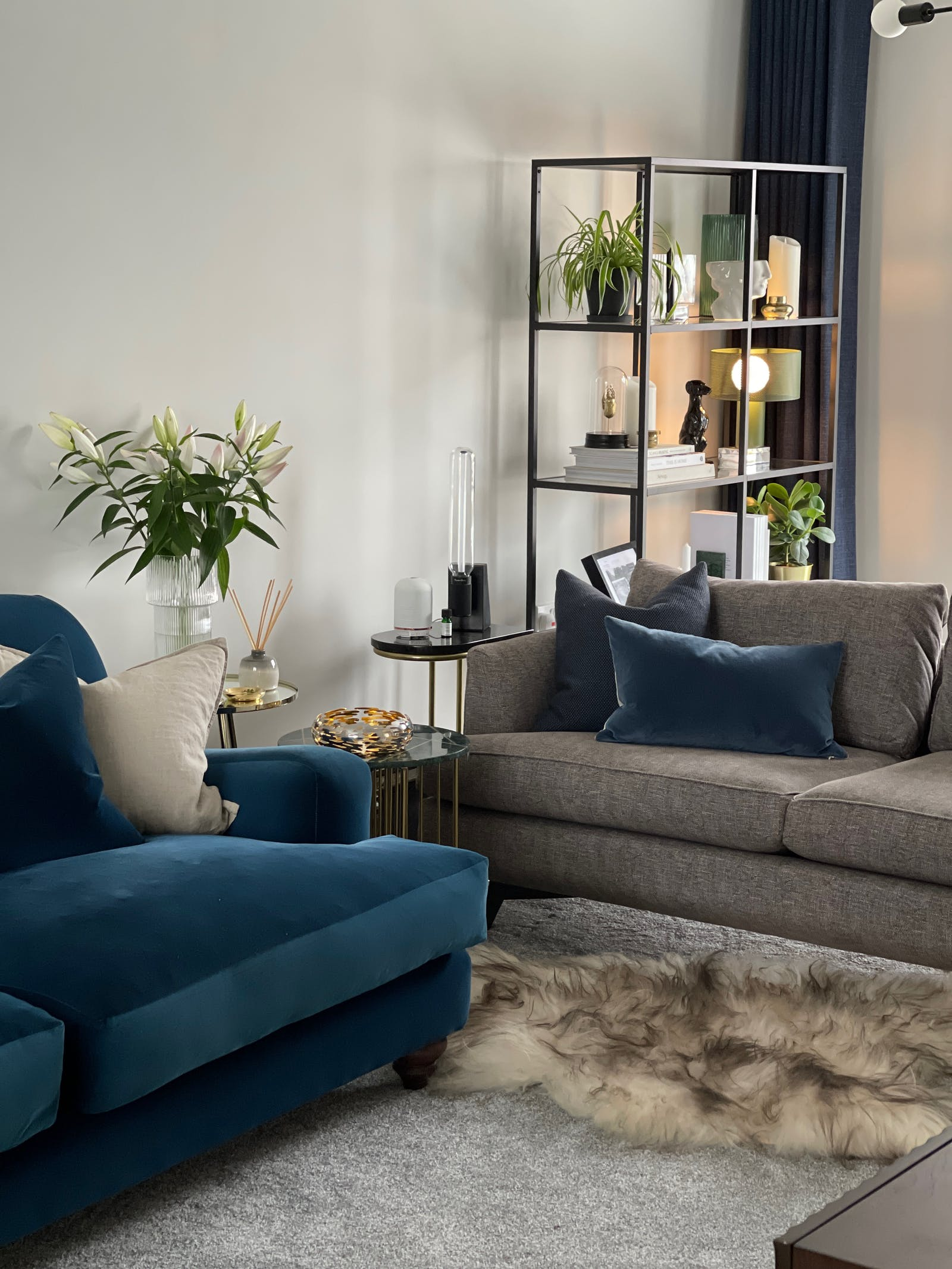 Scandinavian inspired living room with blue and grey furnishings
