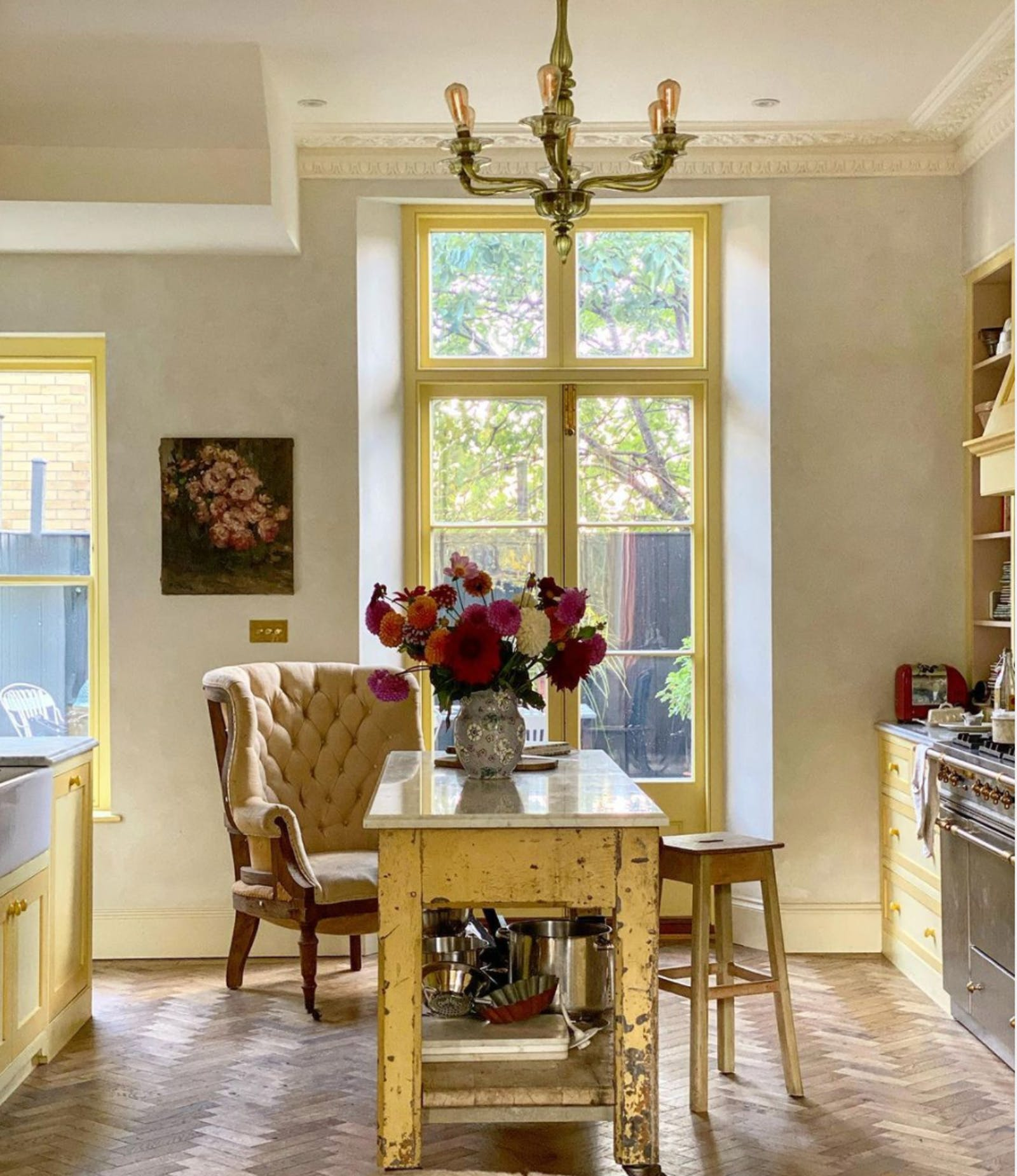 Kitchen with yellow furniture and windows